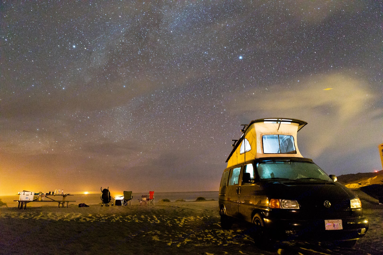 Beach camping = sand and stars and the waves lulling you to sleep. . VW Eurovan Weekender Westfalia 2002
