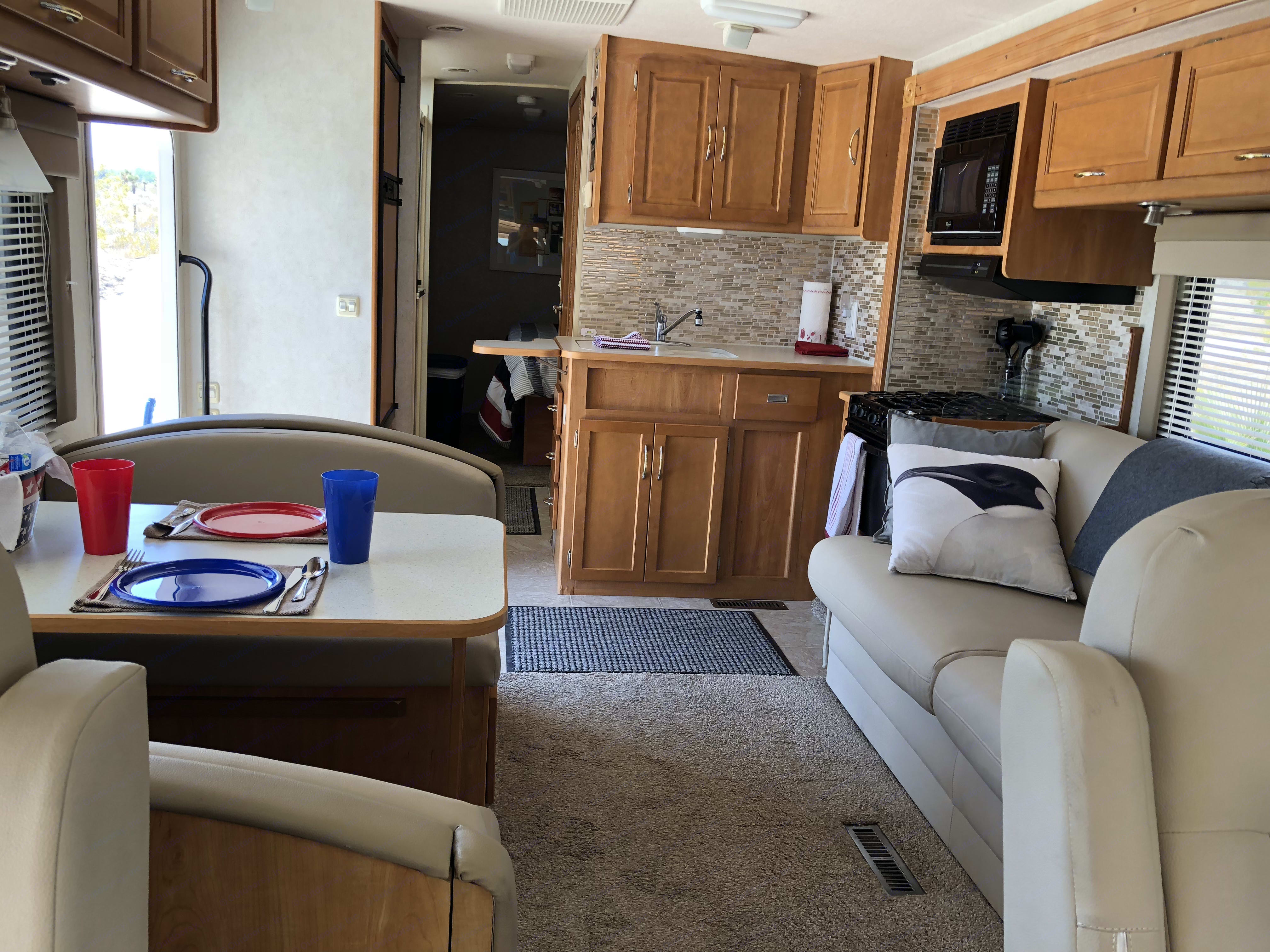 Interior from front to the back with the slide out! Very spacious and comfortable. . Itasca Sunova 2006