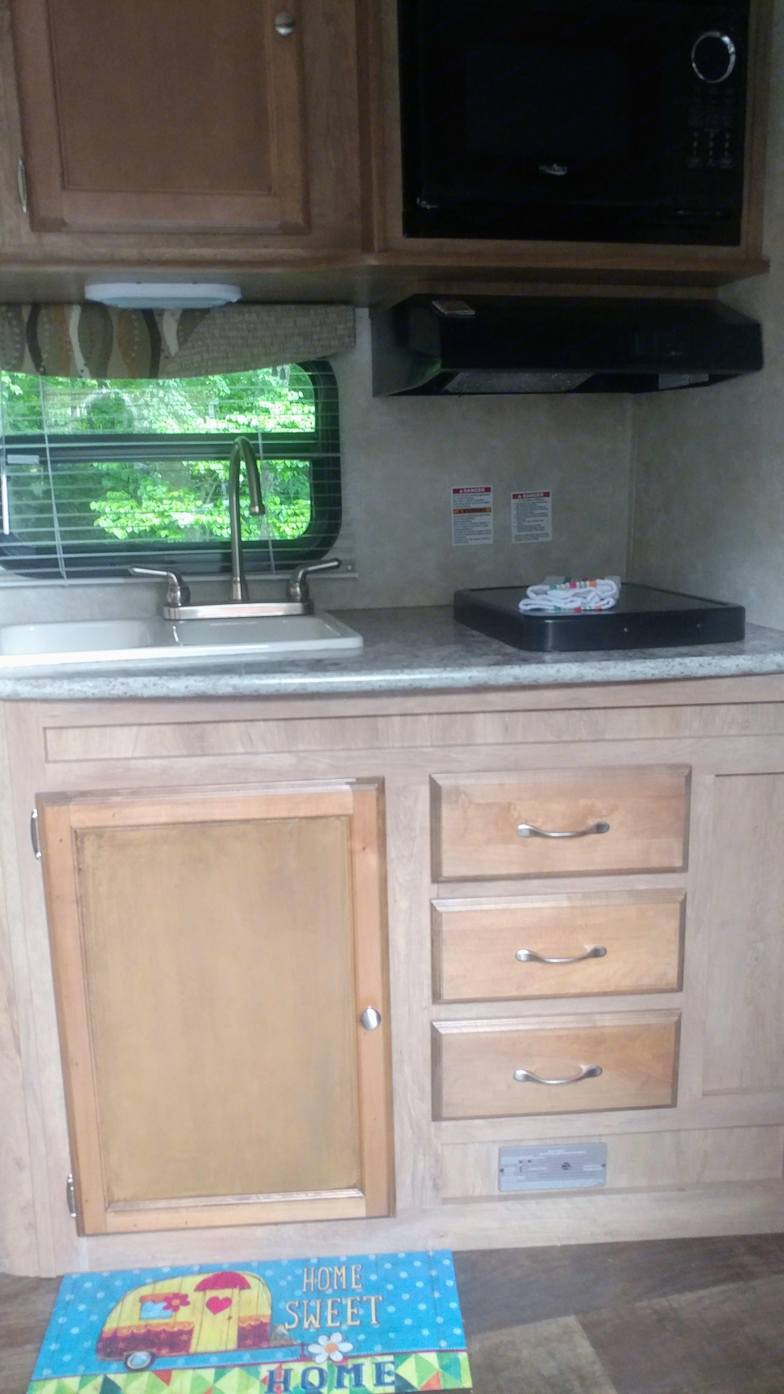 Two burner stove, convection microwave, and double sink. . Gulf Stream Vista Cruiser 2015