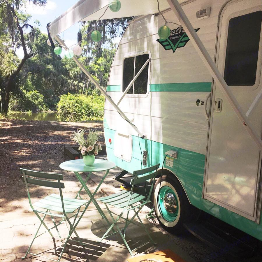 Let us host you in magical Orlando with our charming, vintage-inspired Retro RV as seen in FOUR Magazines!  Included are our outdoor mint chairs + table to match, 50's style checkered outdoor carpet and sweet welcome mat.. Riverside Rv Retro 2018