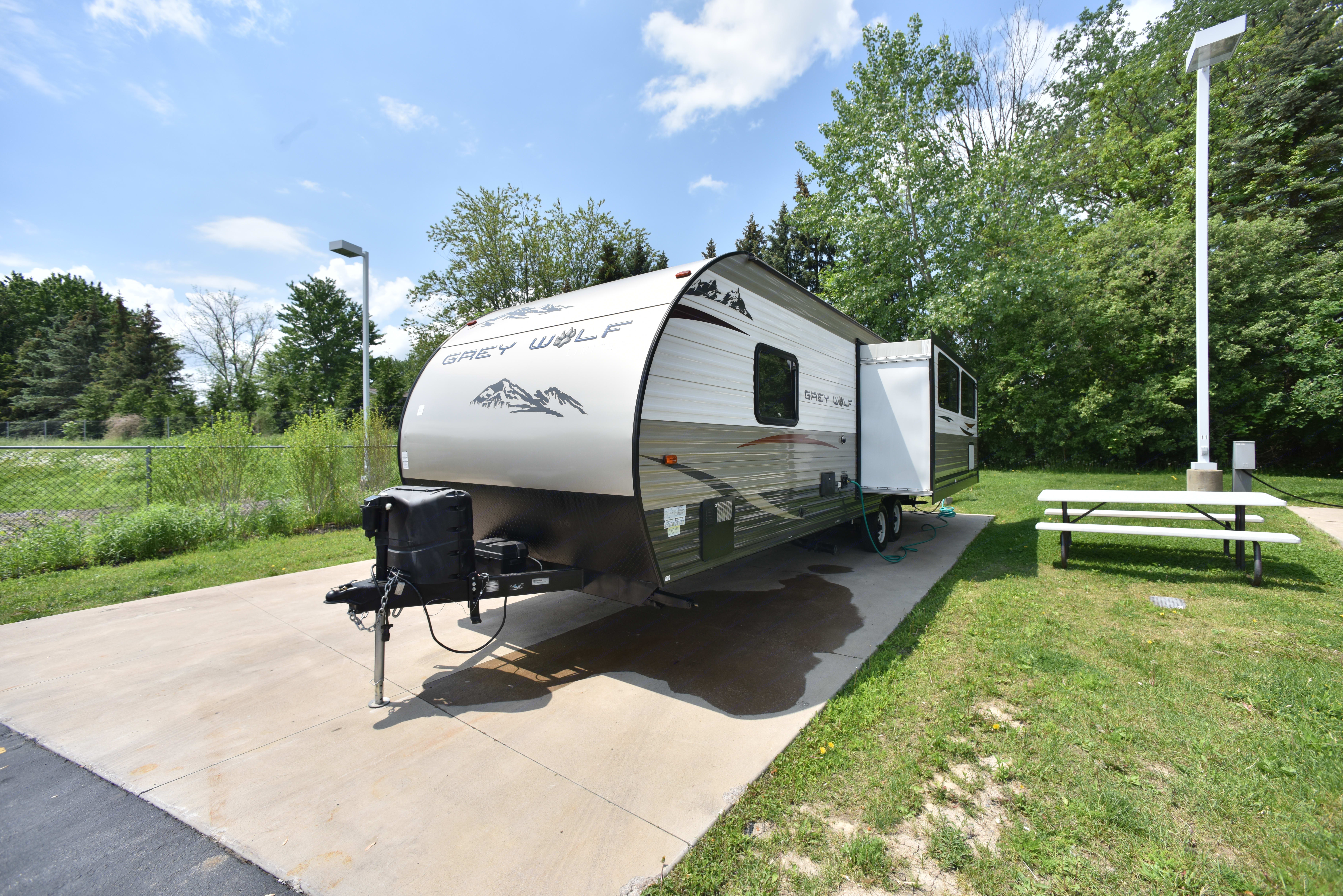 Long shot of trailer with dining area open . Forest River Cherokee Grey Wolf 2015