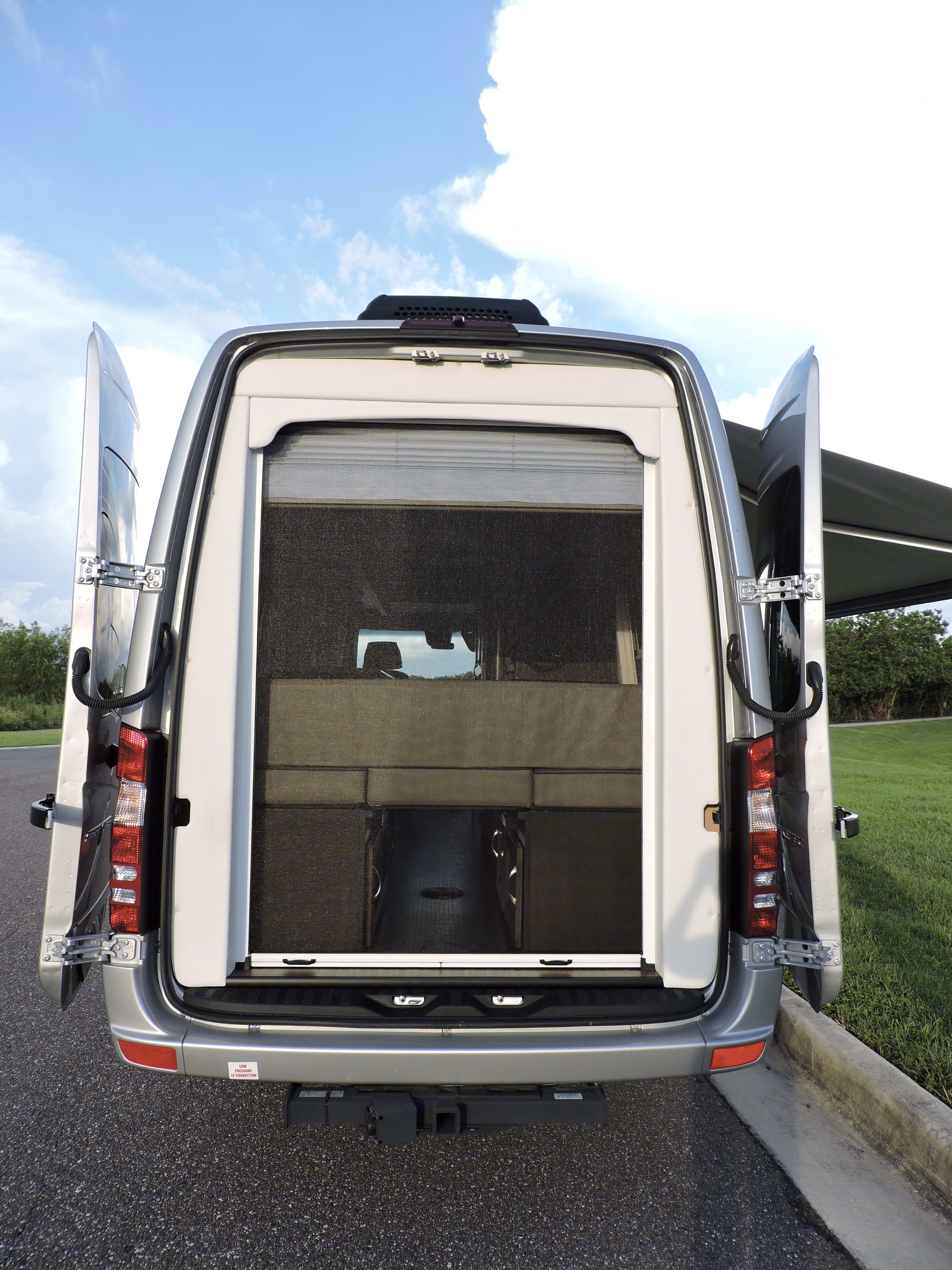 Back doors fully open for a clear view, with a full screen to keep out unwanted pests.. Coachmen Galleria 2018