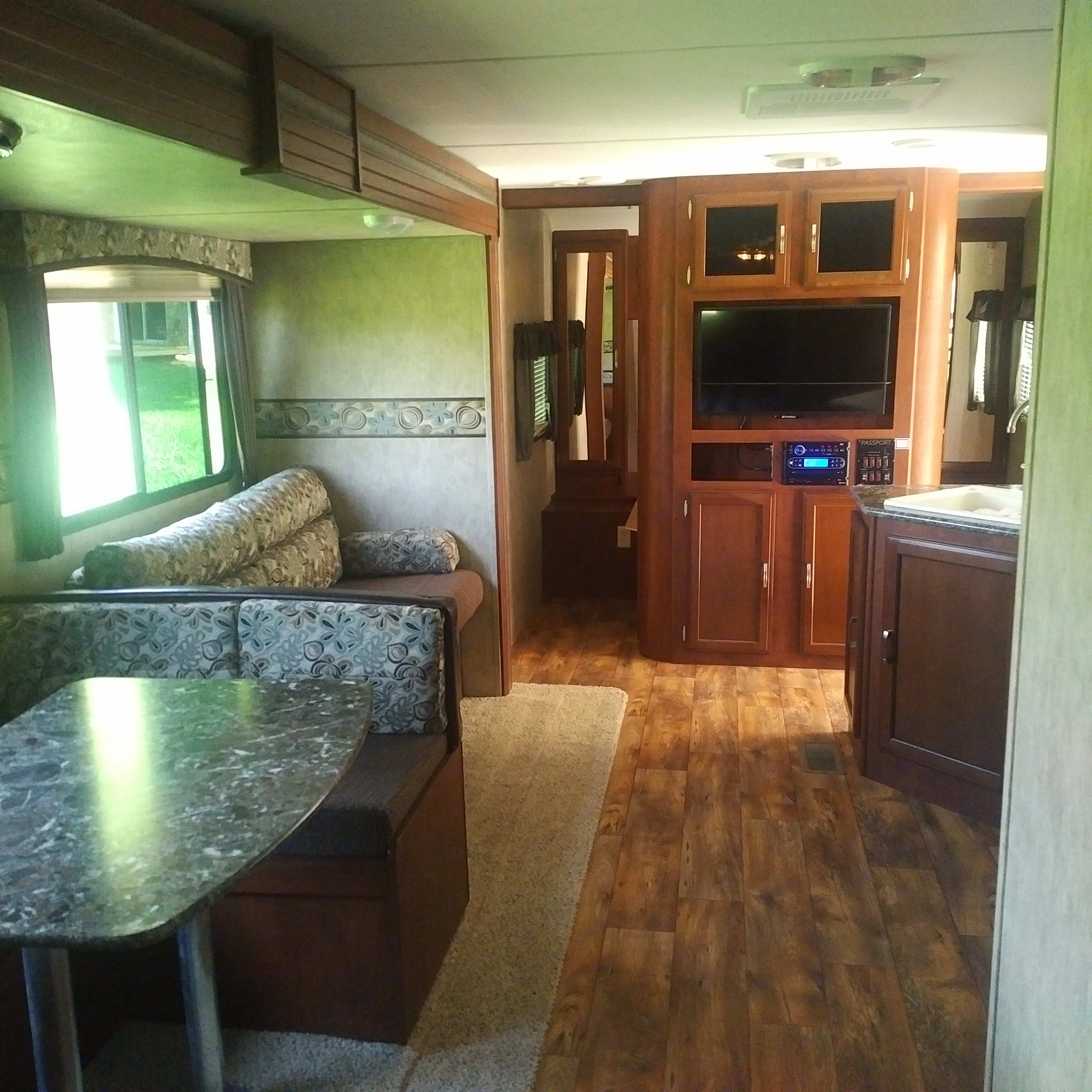 master bedroom behind cabinet with closing doors.  TV, stereo and cd player in cabinet.. Keystone Passport 2015