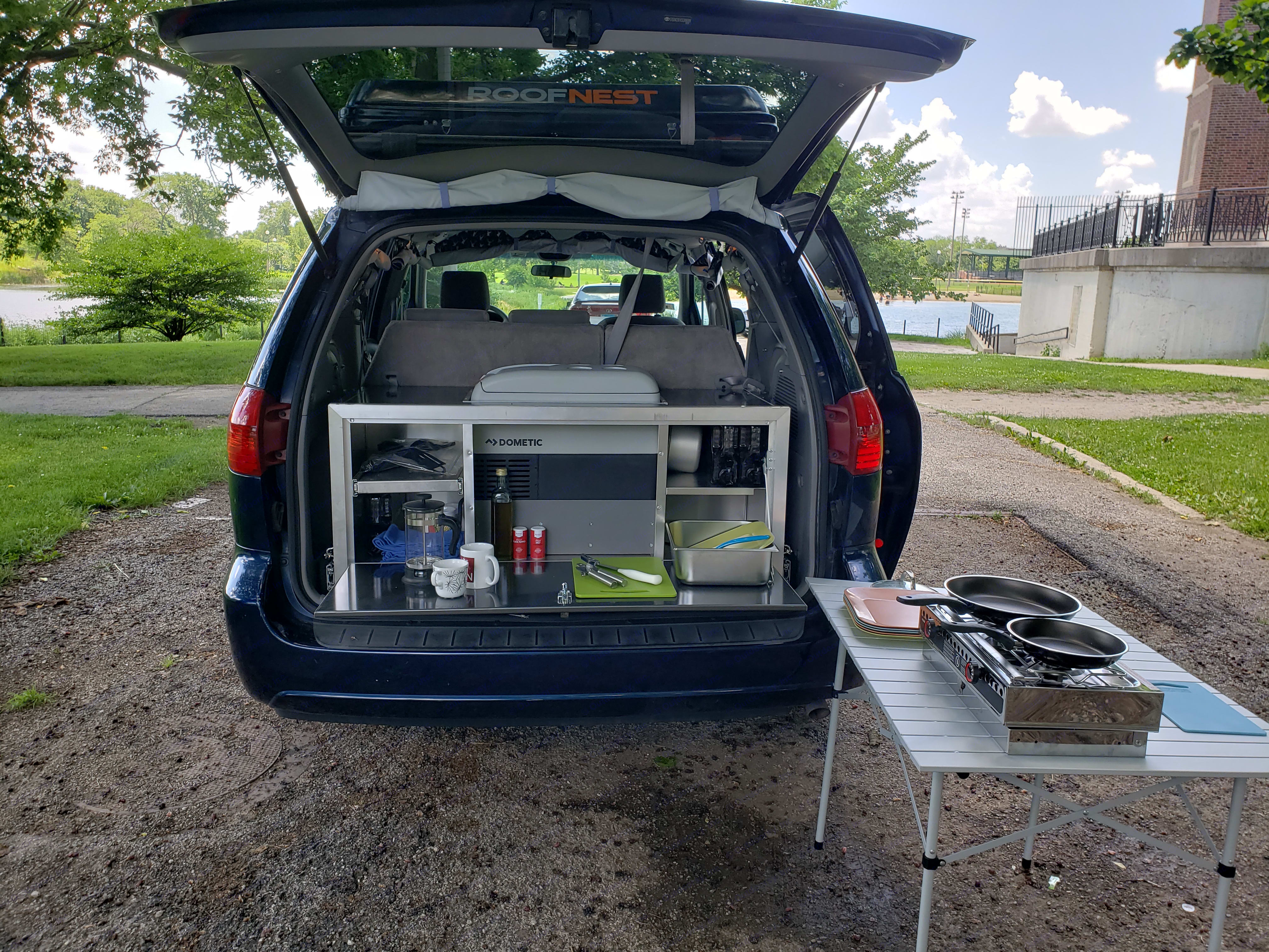 Refrigerator, 2 burner alcohol stove, wash basins, water tanks, kitchen essentials. Extra table for prep/outside dining.. Toyota Sienna 2005