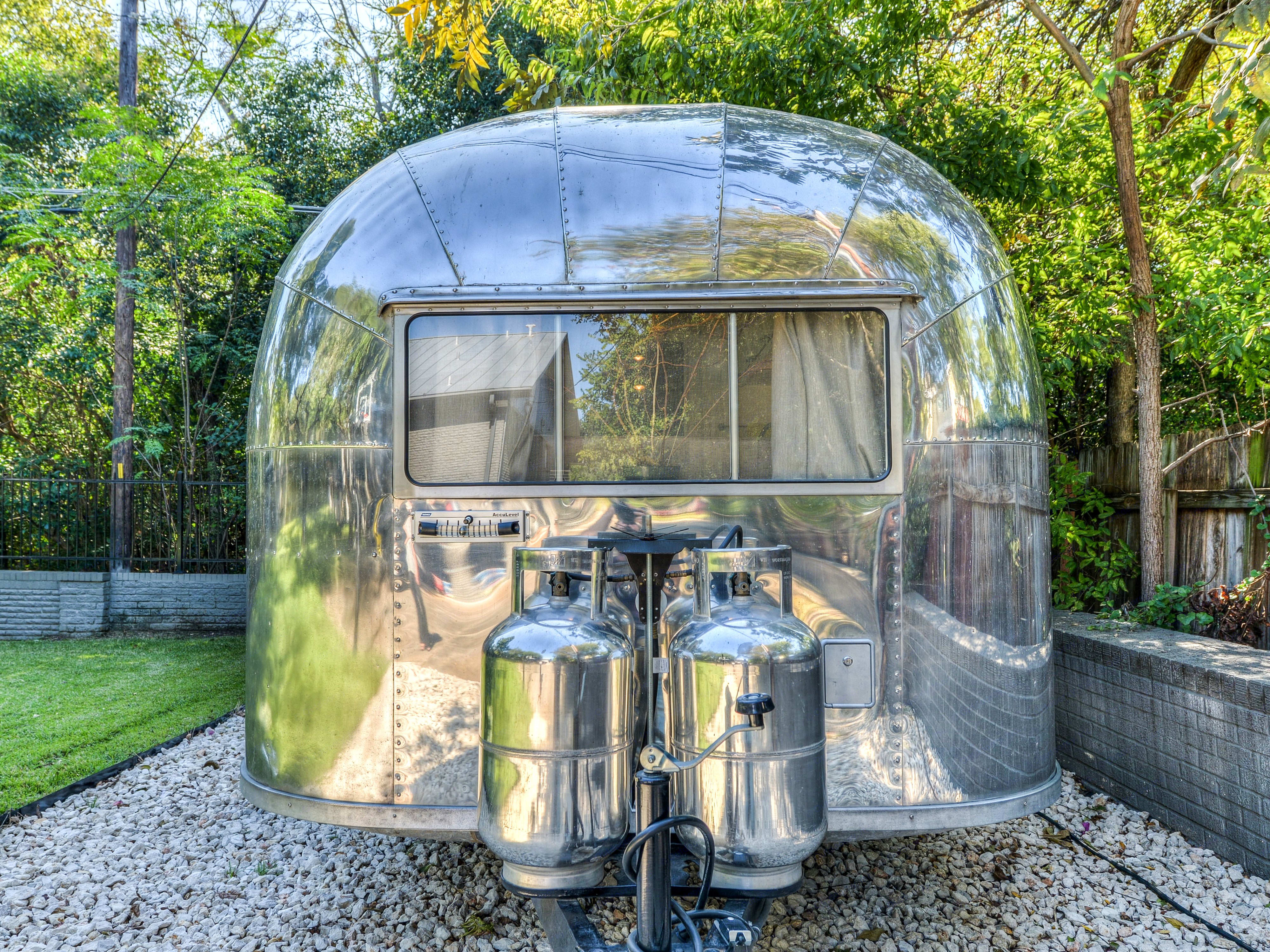 2 propane tanks included.  All windows are fully functional.. Airstream Crusier 1958