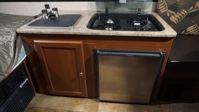 Four burner stove, mini fridge and a sink.. Forest River Rockwood Premier 2016