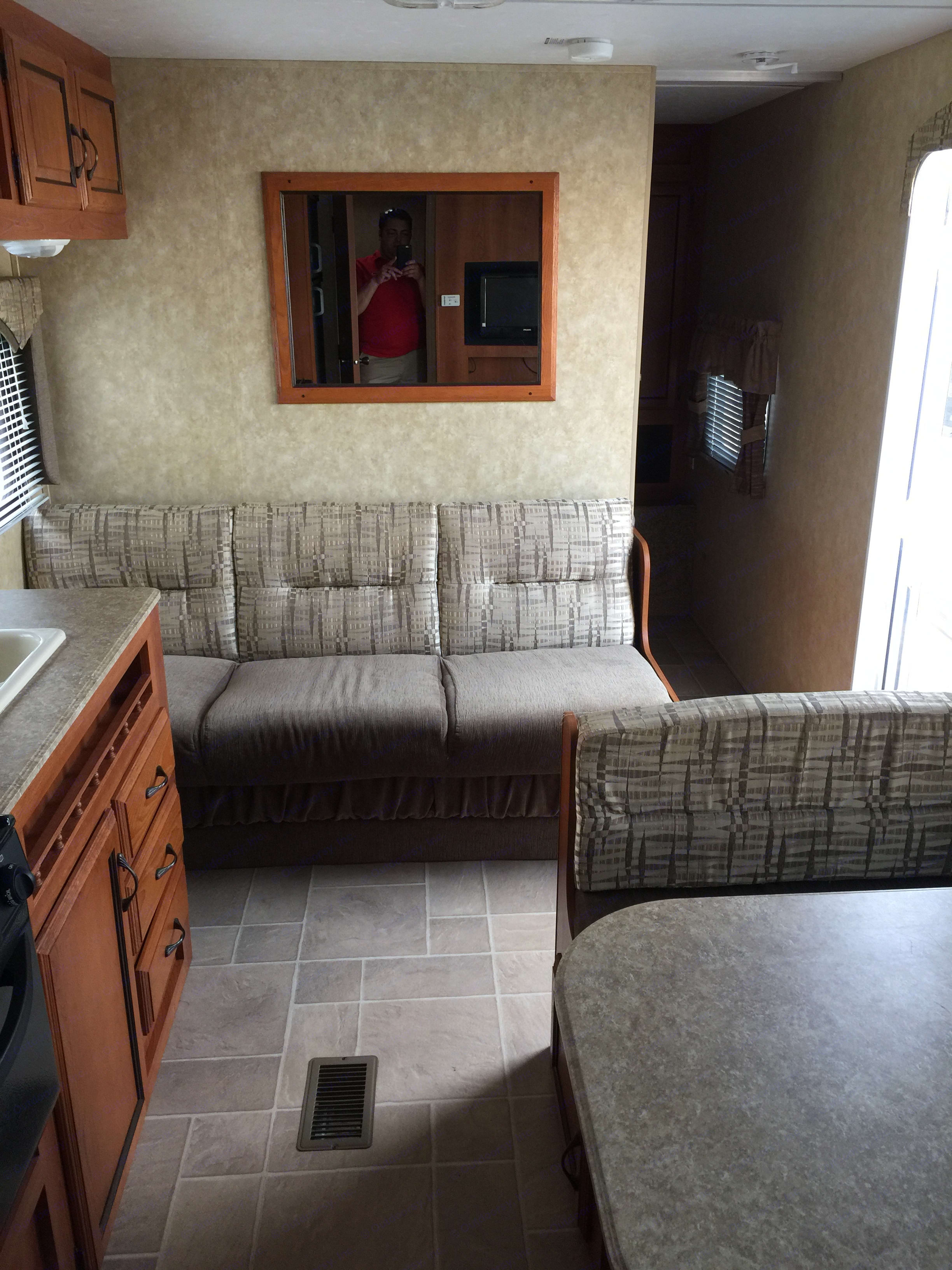 Couch folds into a full size bed. Coachmen Catalina 2010