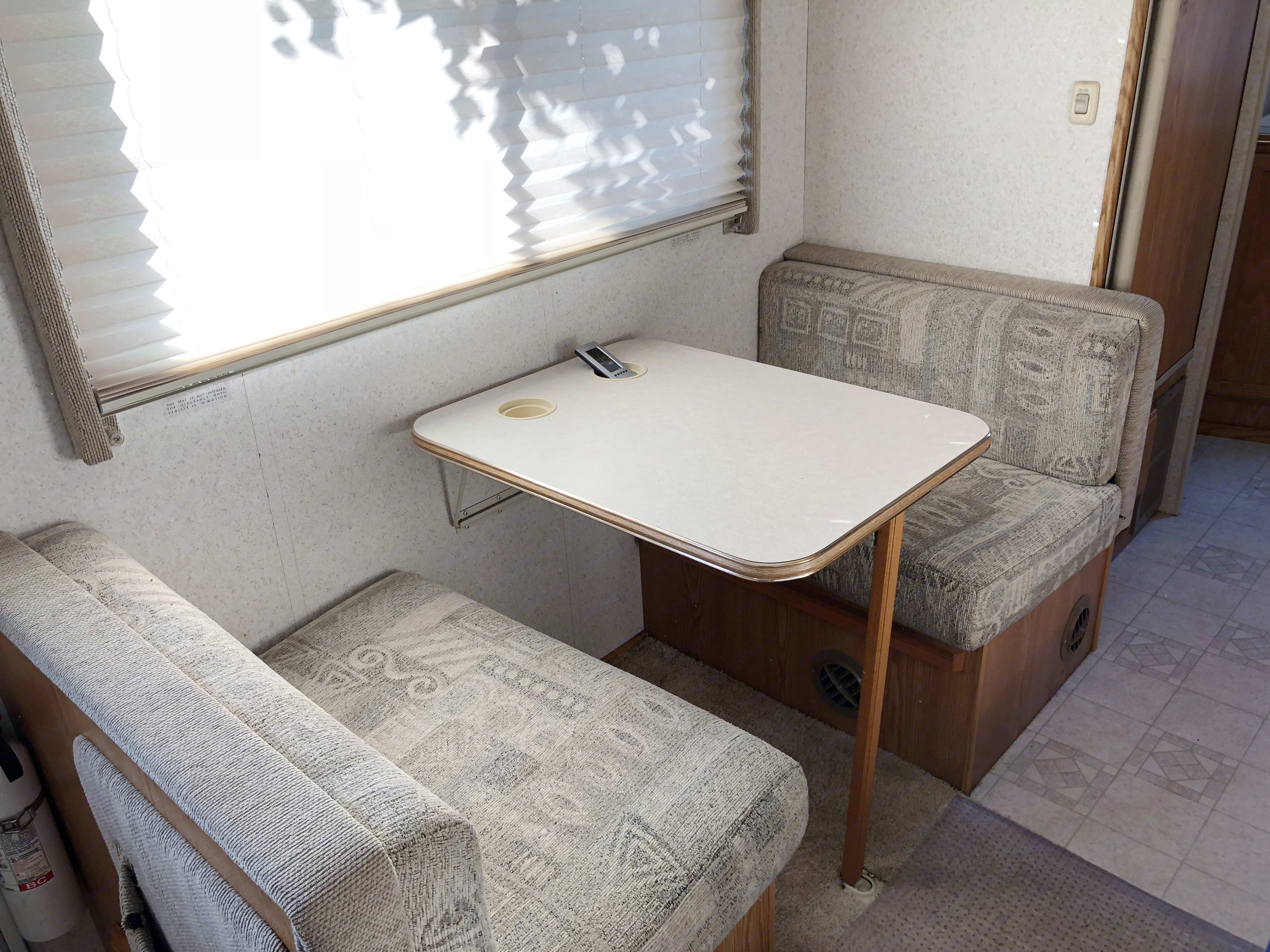 Folds out into a third twin bed (sleeps 1 adult or 1-2 kids).. Winnebago Vista 2002