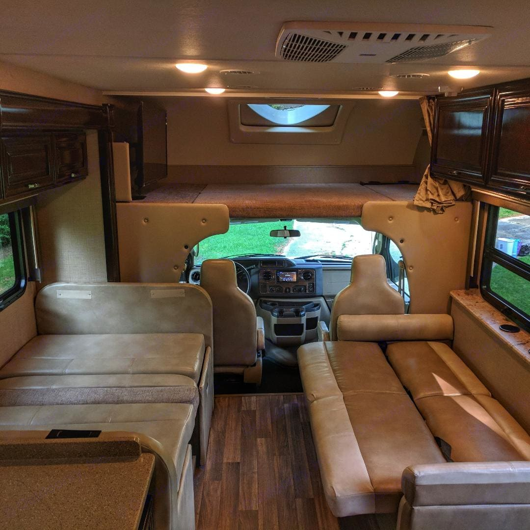 Dining table and couch fold out for extra beds. Thor Motor Coach Quantum 2018