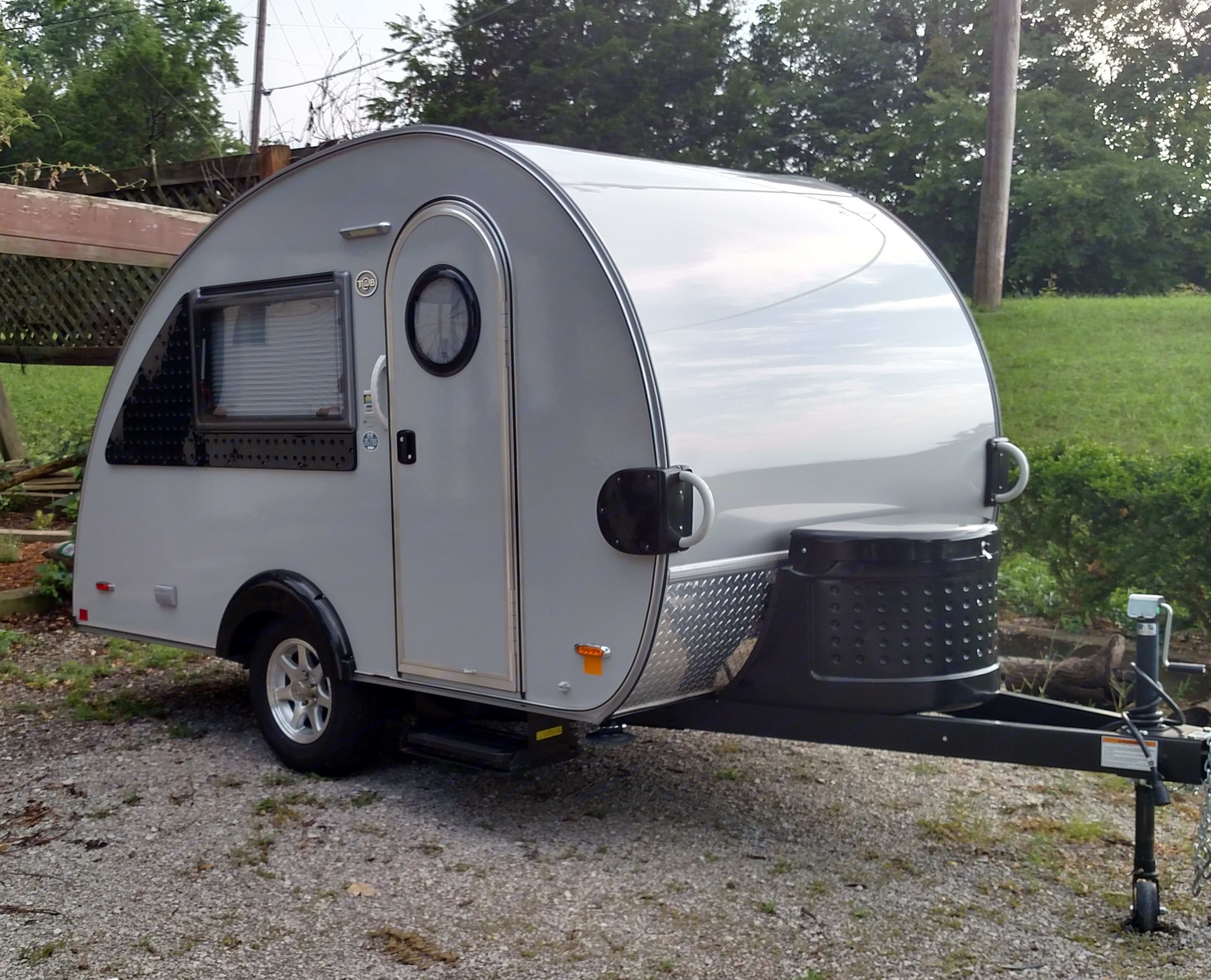 Front view with propane tank, dumping hose and battery storage. Little Guy T@B 2016