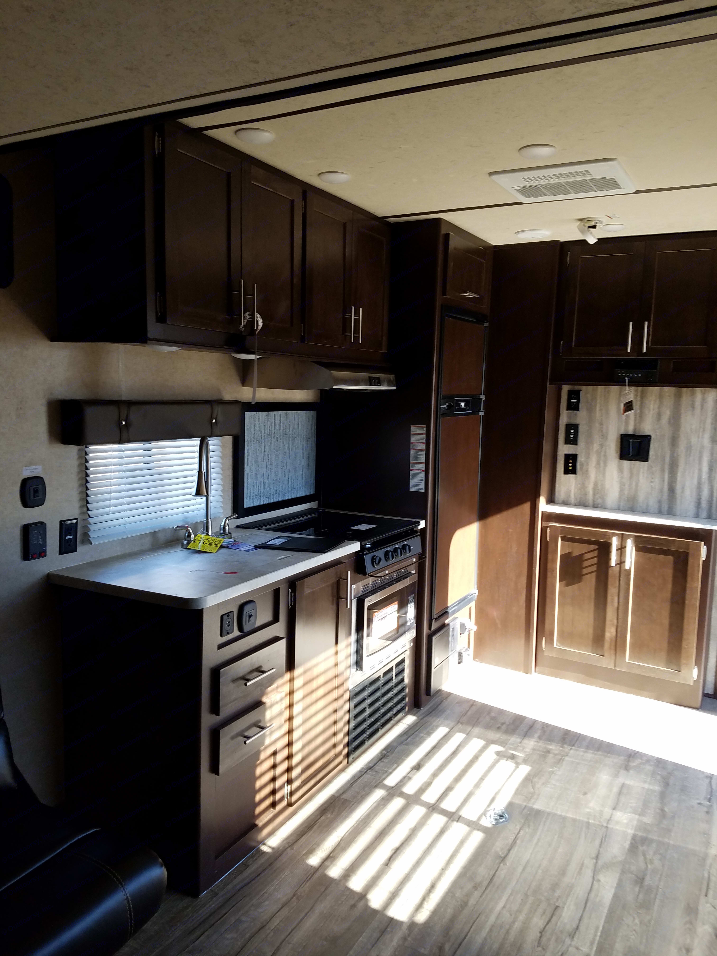 The Kitchen here features a convection oven/ microwave. Large sink and large refrigerator. . Forest River Wolf Pack 2017