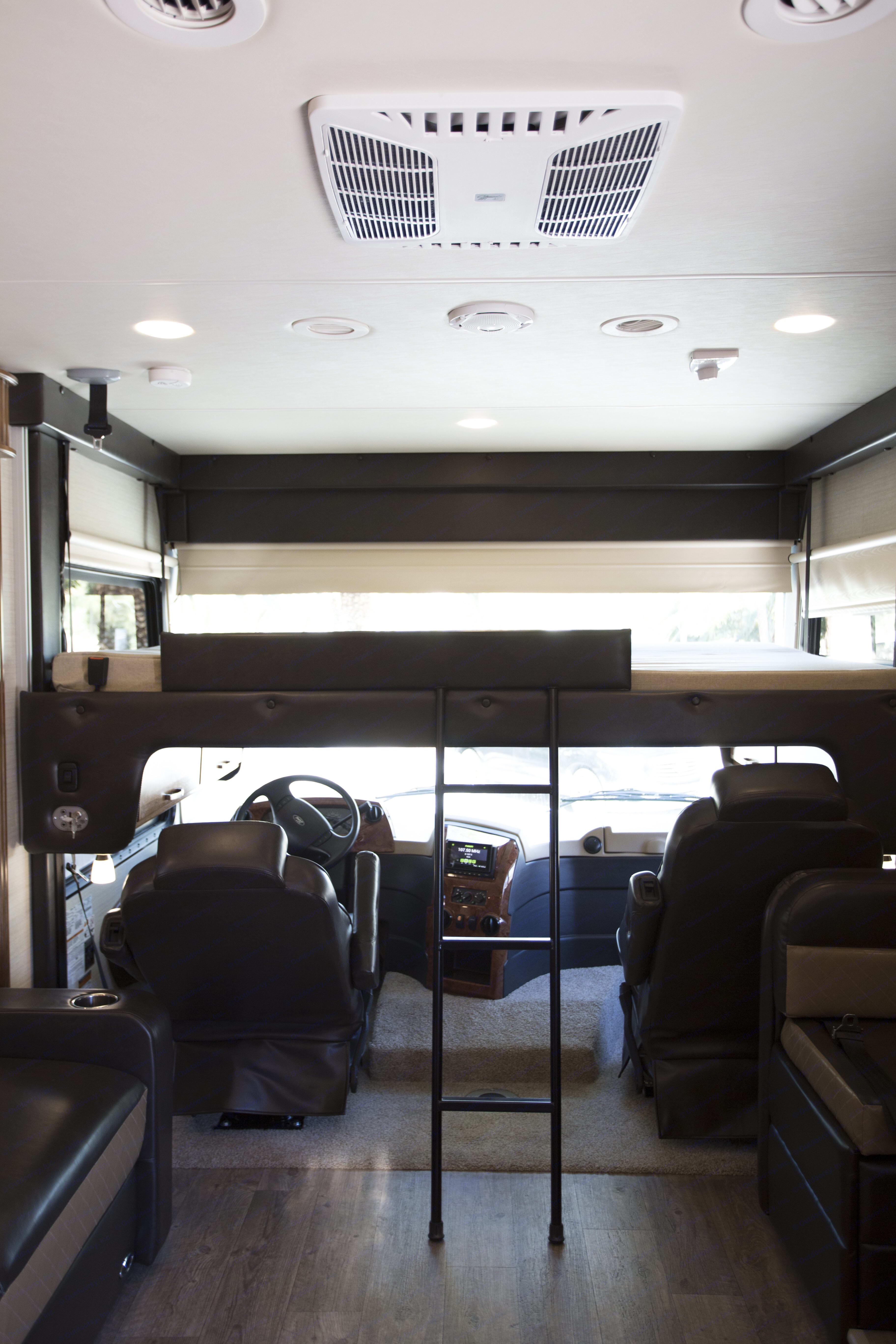 Overhead Full size bed with rails. Jayco Precept 2018