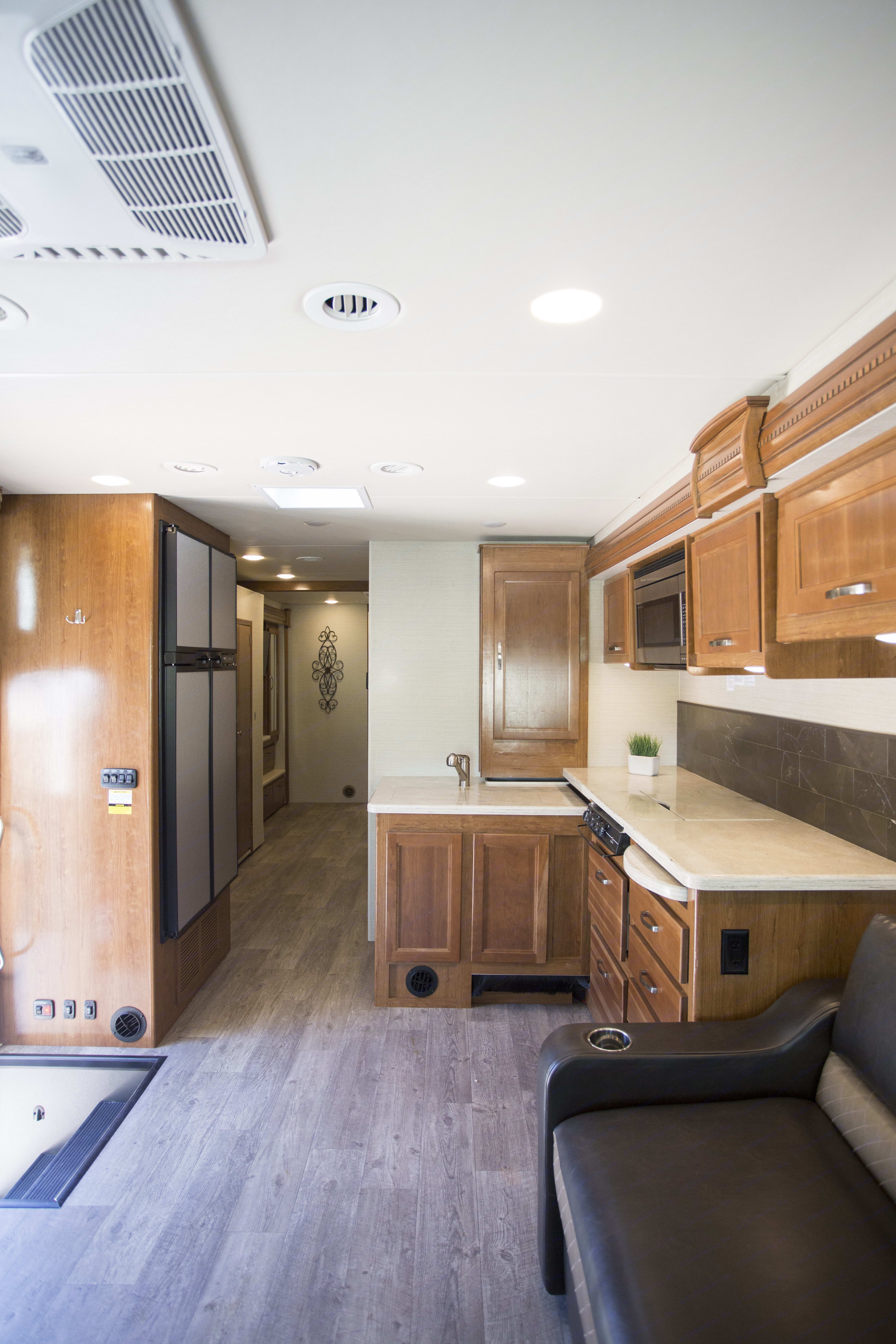 Almost a full size refrigerator with plenty of room to cook.  3 Burners available. Jayco Precept 2018