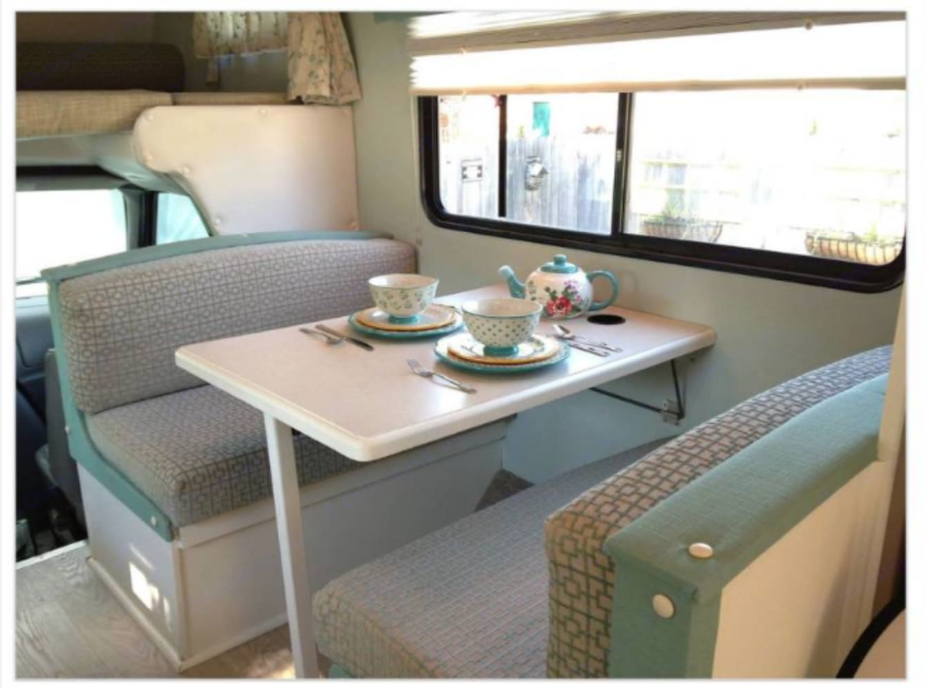 Dinette seats four and converts to a bed (sleeps 1-2). Forest River Sunseeker 2000