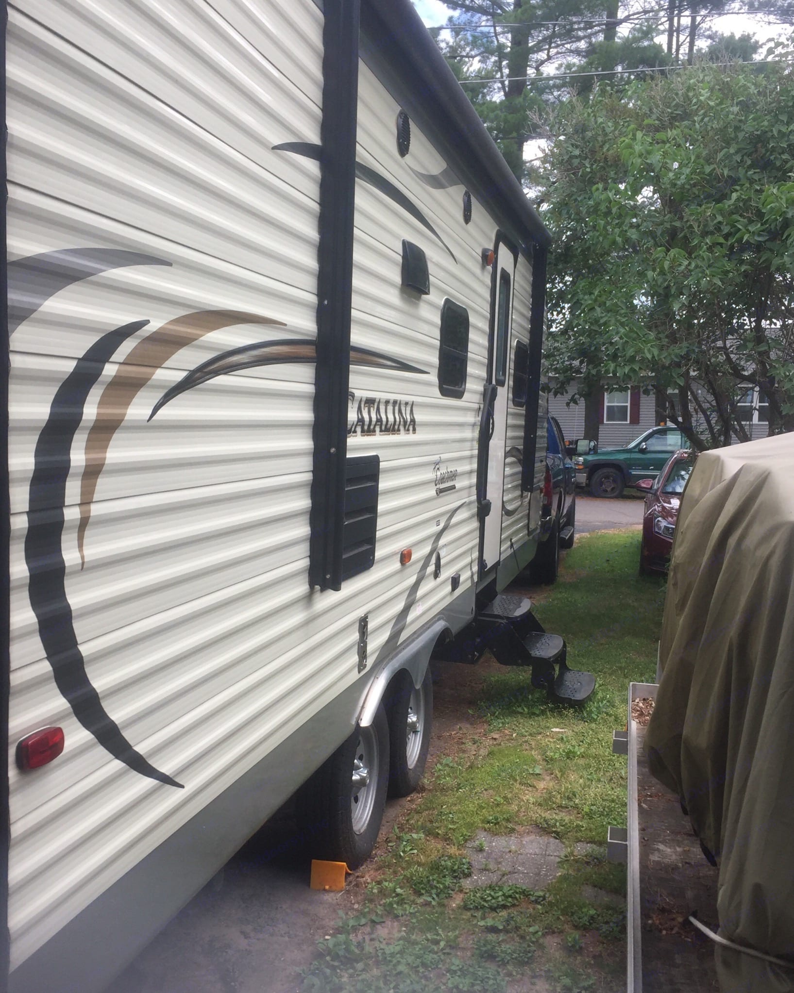Right side of trailer. 3 stairs to door with an electric awning.. Coachmen Catalina 2014