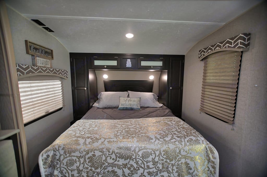"""Queen Murphy Bed in """"out"""" position. Hidden night stand on each side. . Venture Rv Sonic 2018"""