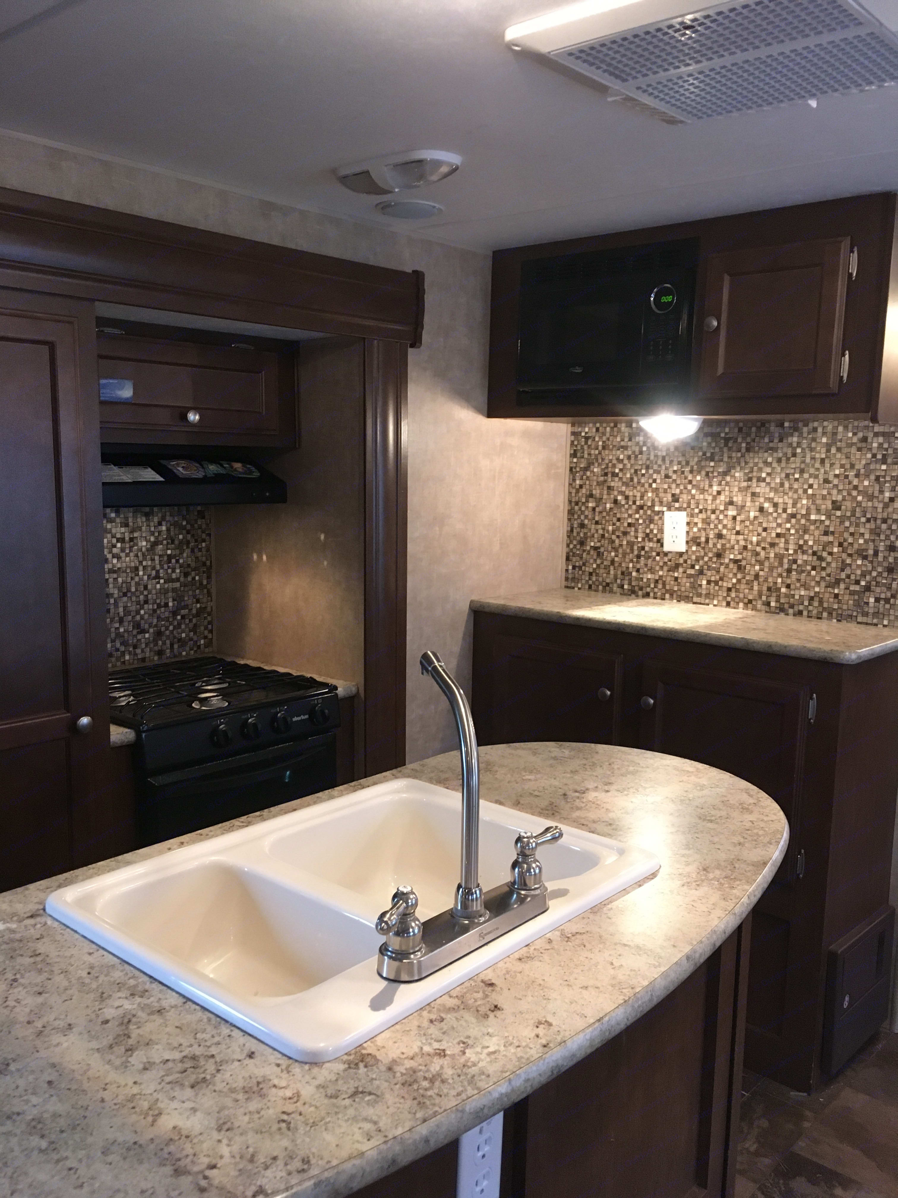 Beautiful kitchen with island. Venture Rv Sporttrek 2014