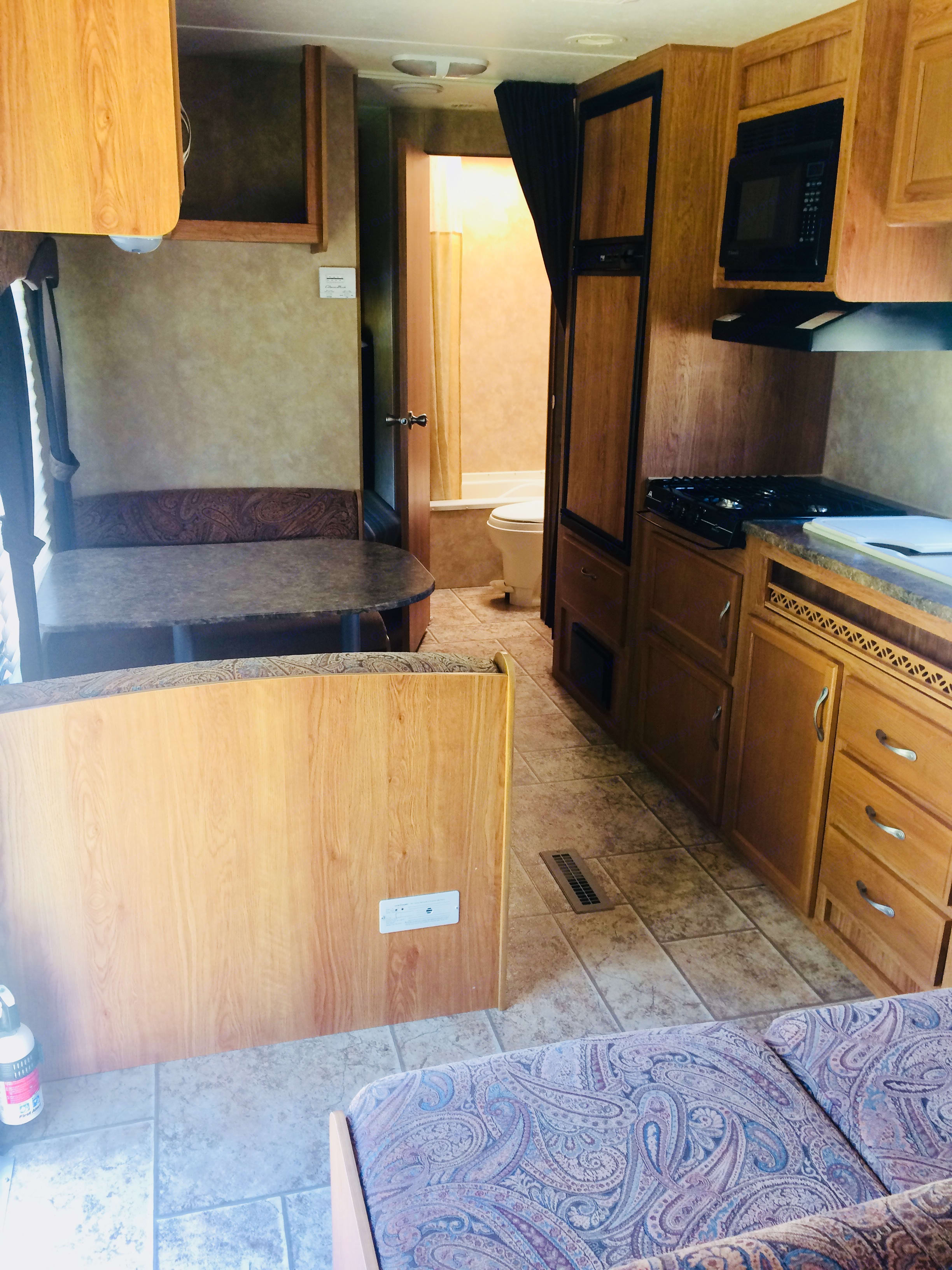 Dining table folds down into bed. Large kitchen area.. Jayco Jay Flight 26BH 2010