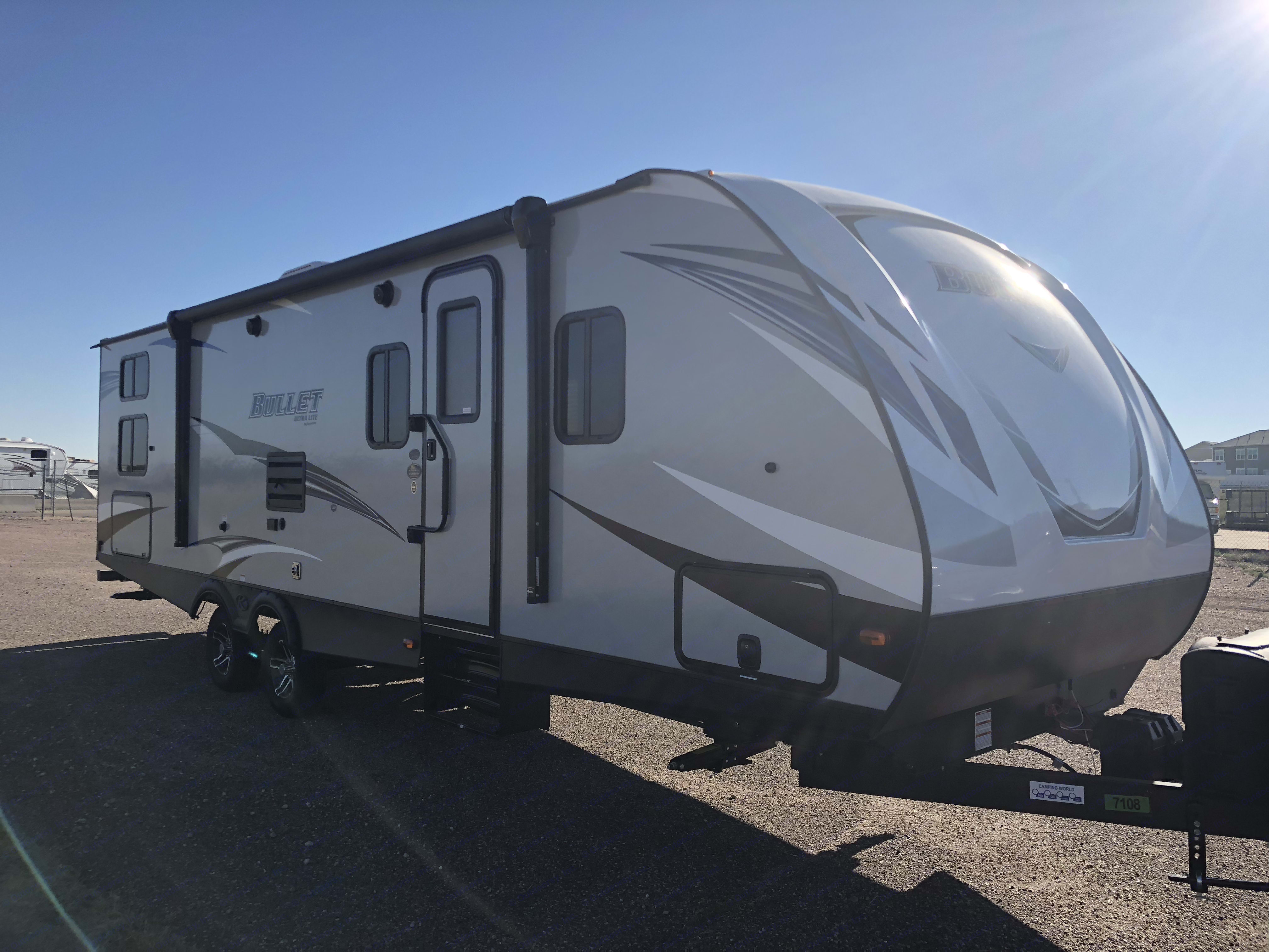 Left side has door, awning, outdoor kitchen (bottom panel) and grill. Exterior LED lights under the awning and an outdoor stereo speakers.. Keystone Bullet 287 QBS 2019