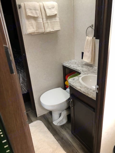 Rooming bathroom. Soap, towels, toilet paper, and toilet brush.. Jayco Jay Flight 2018