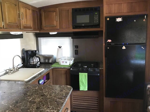 Kitchen has microwave, oven, stove top, double sink, refrigerator & freezer; Included: Dishes for 6 including glassware. All necessary sponges, dish detergent; 3 pots with lids and skillet; plates for 4; paper plate; ice trays & maker for summer usage. Has toaster, coffee maker and Insta-pot for quick meals.. Keystone Springdale 2015