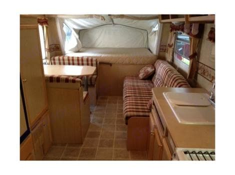 Interior with the front bed opened. . Jayco Jay Feather Ultra Lite 2004