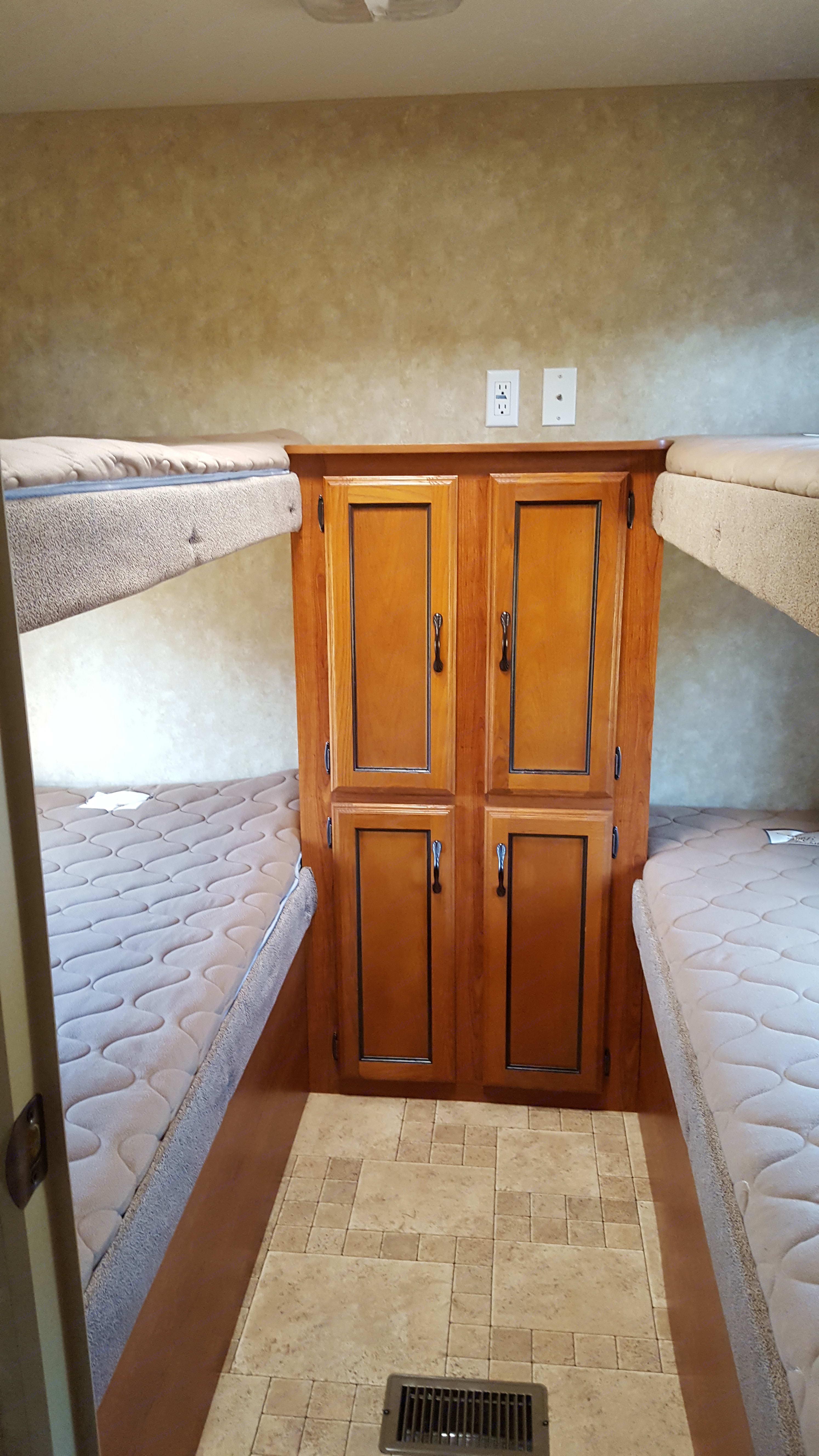 Wardrobe in bunkhouse . Coachmen Catalina 2012