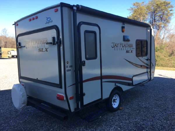 View of trailer in the storage compact and hauling condition...trailer is not setup for use yet. Dry weight is super light for vehicles with limited towing weights.. Jayco Jay Feather Ultra Lite 16XRB 2014