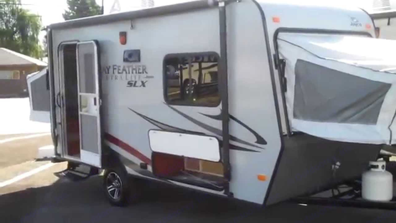 Depicts trailer in the setup for use condition. The Hybrid is a fully functional hard shell trailer with all trailer amenities where the sleeping areas are the tent trailer ends.. Jayco Jay Feather Ultra Lite 16XRB 2014