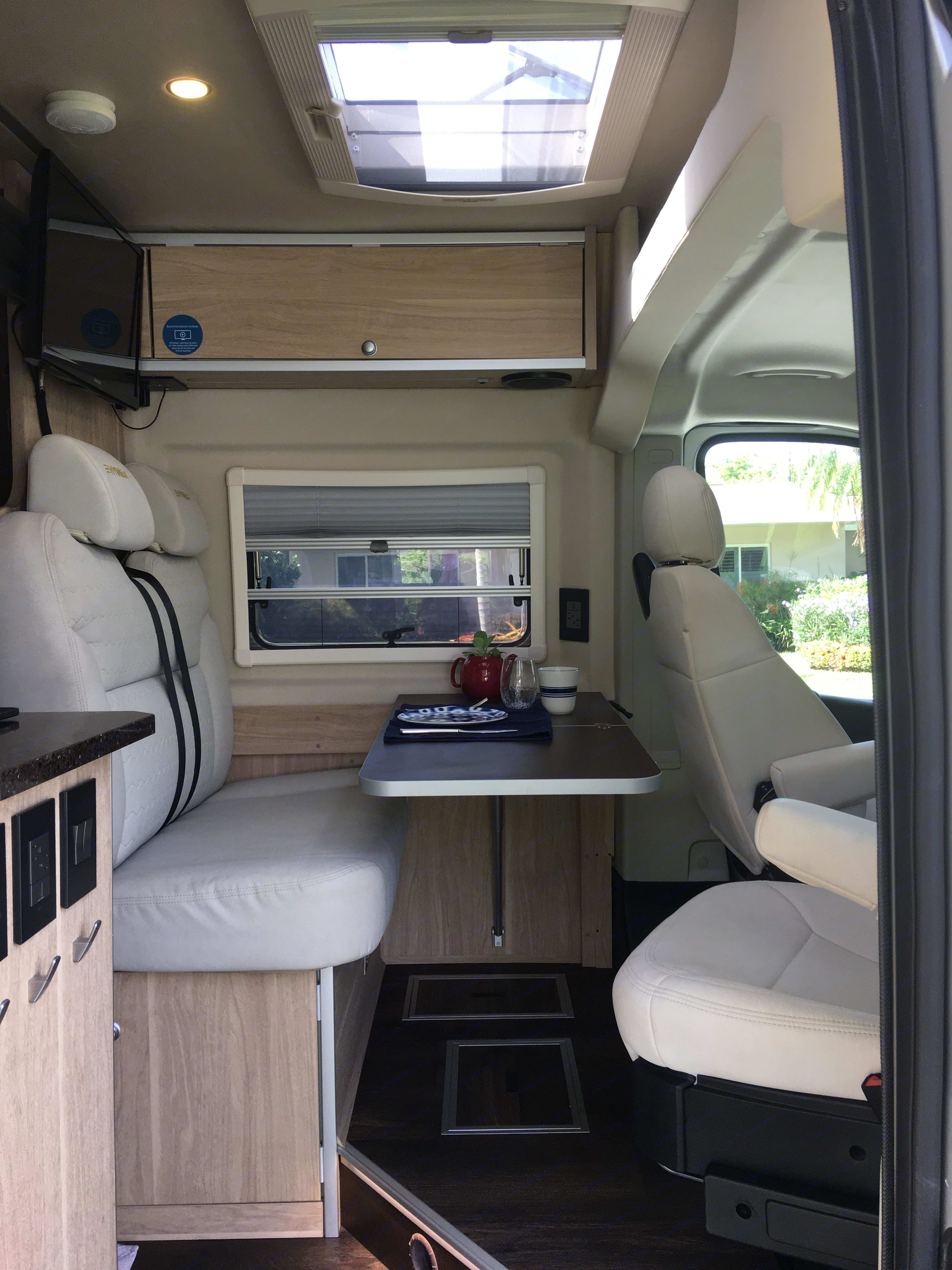 Bench with table and lounge area. Note TV. . Hymer Aktiv 2017