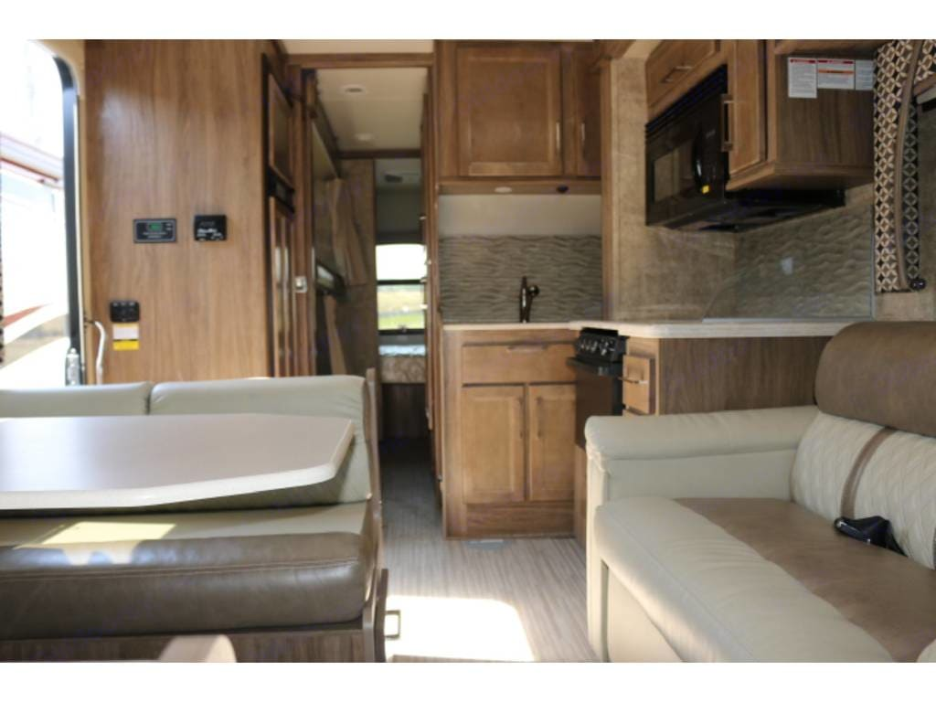 Slides are retracted here to show how the RV looks when driving.. Jayco Greyhawk 2018