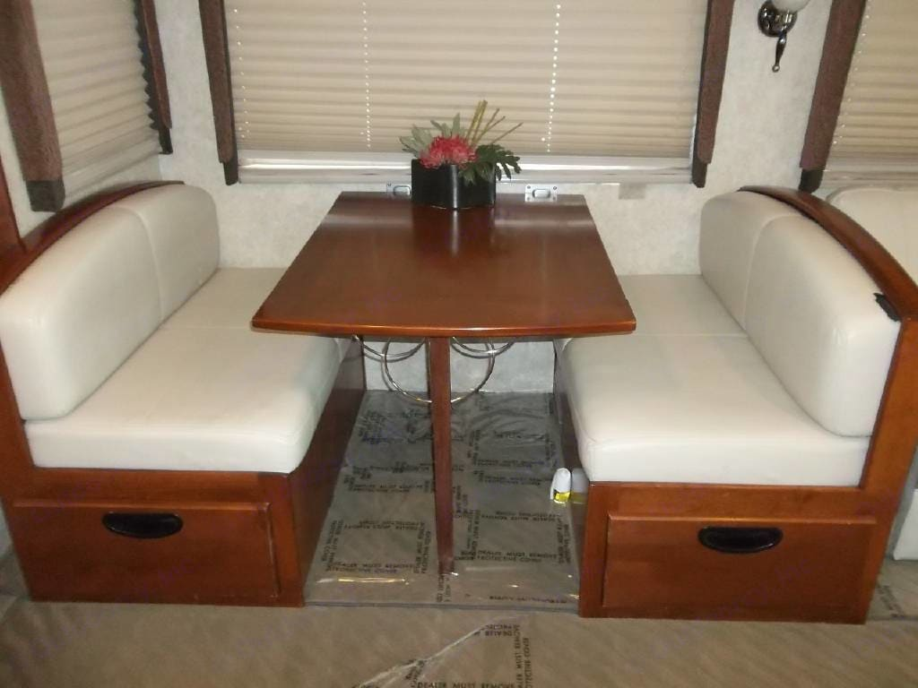 Dining table that folds down and turns into a bed. Fleetwood PaceArrow 2004