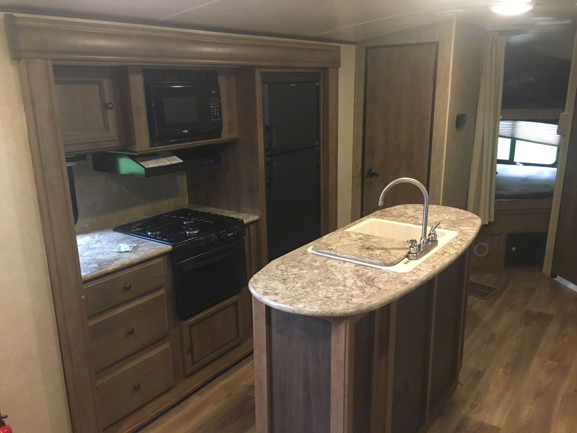 Kitchen includes propane/electric fridge, island with double sink, microwave, gas range/oven, as well as plenty of storage.. Cruiser Rv Corp Shadow Cruiser 2016