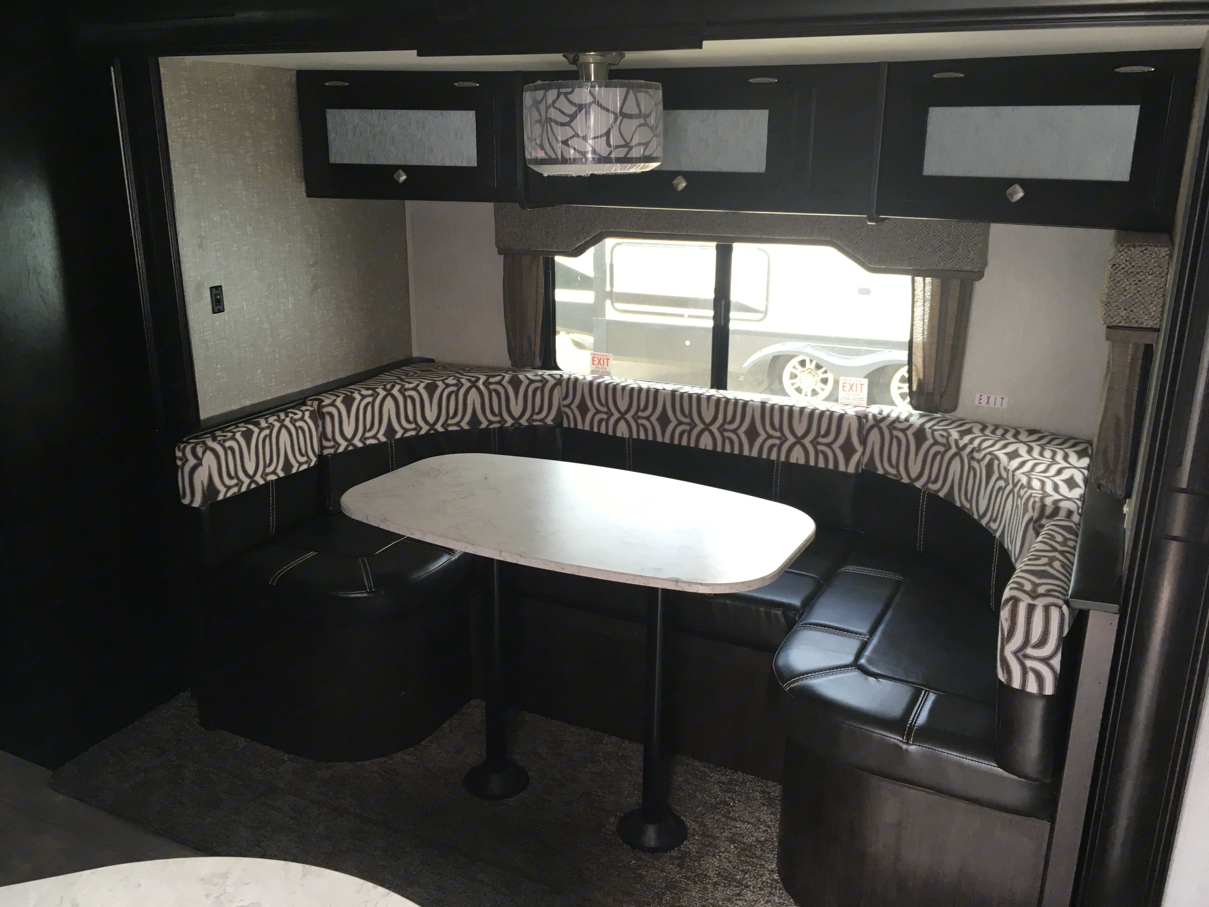 Dining and sitting area that also folds down in a sleeping area.  Storage underneath seating.. Heartland North Trail 2018