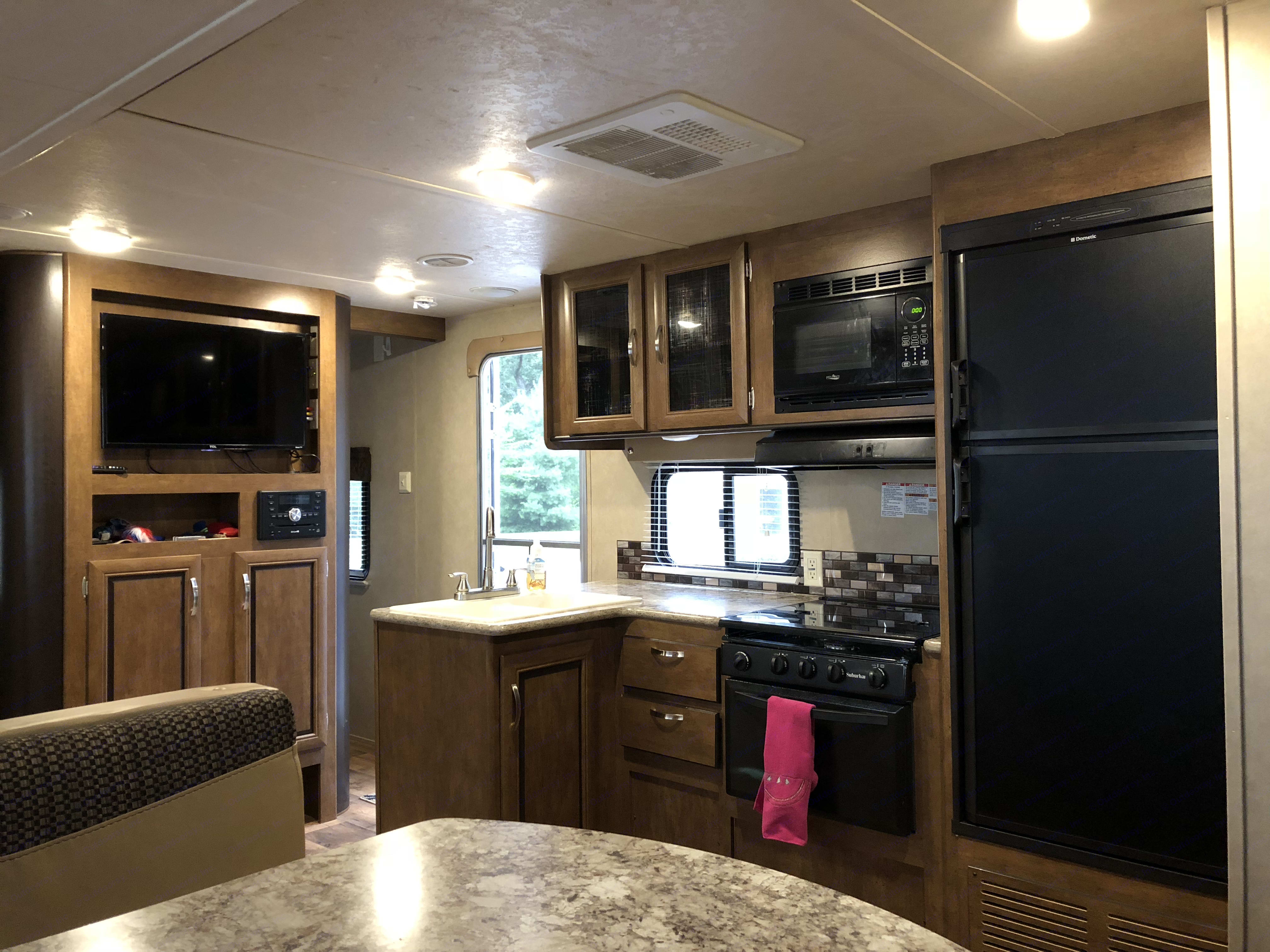 The kitchen area is open, and spacious with all of the amenities you would need to be comfortable.  . Forest River Cruise Lite 2017