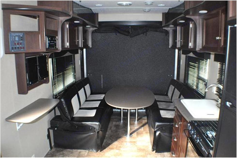 Two couches double as a dining table or fold flat for a bed that can fit three. Plenty of overhead storage for food, clothes, gear, or whatever else you may need to store. . Dutchmen Rubicon 2015