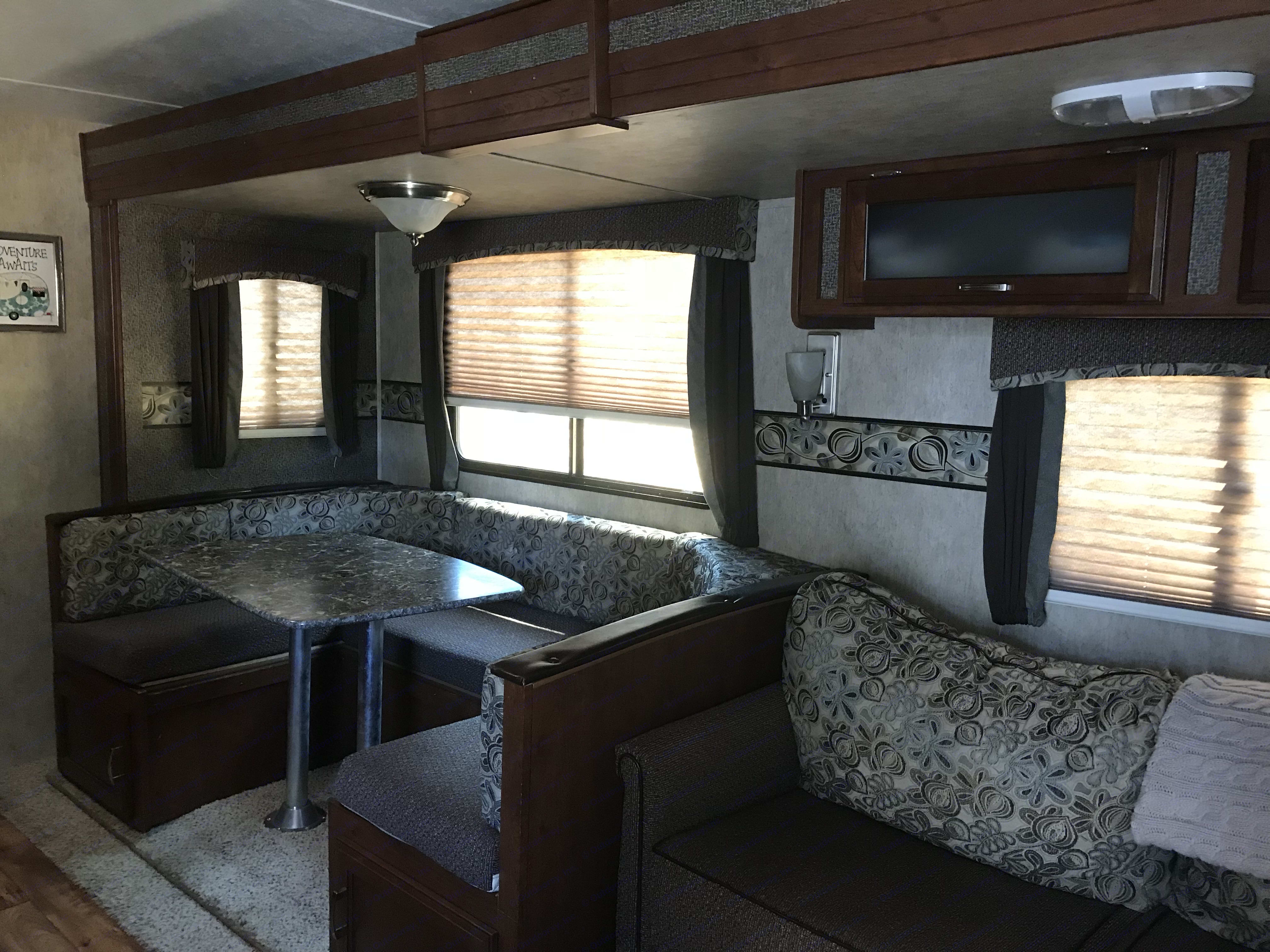 Dinette and couch that both can be made into beds. Keystone Passport 2014