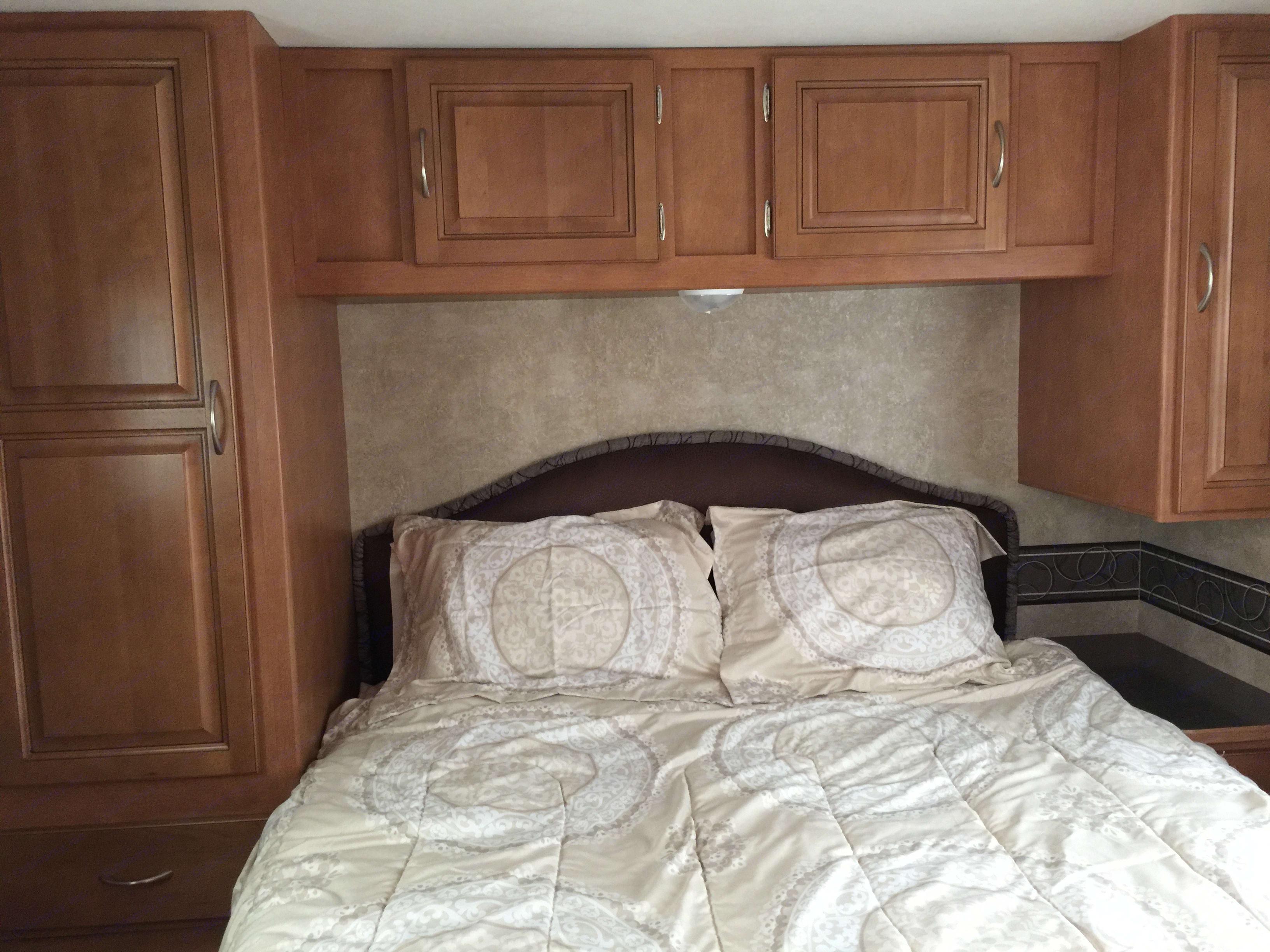 queen-size bed in separate room, with plenty of storage.. Winnebago Minnie Winnie 2014