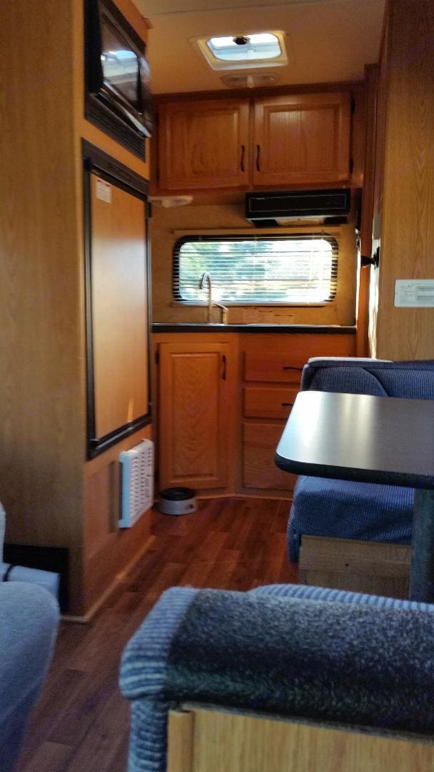 Kitchen, with stove, sink, frig, microwave. All utensils, pots/pans, coffee maker, etc. included at no charge. Thor Motor Coach Four Winds Majestic 2010