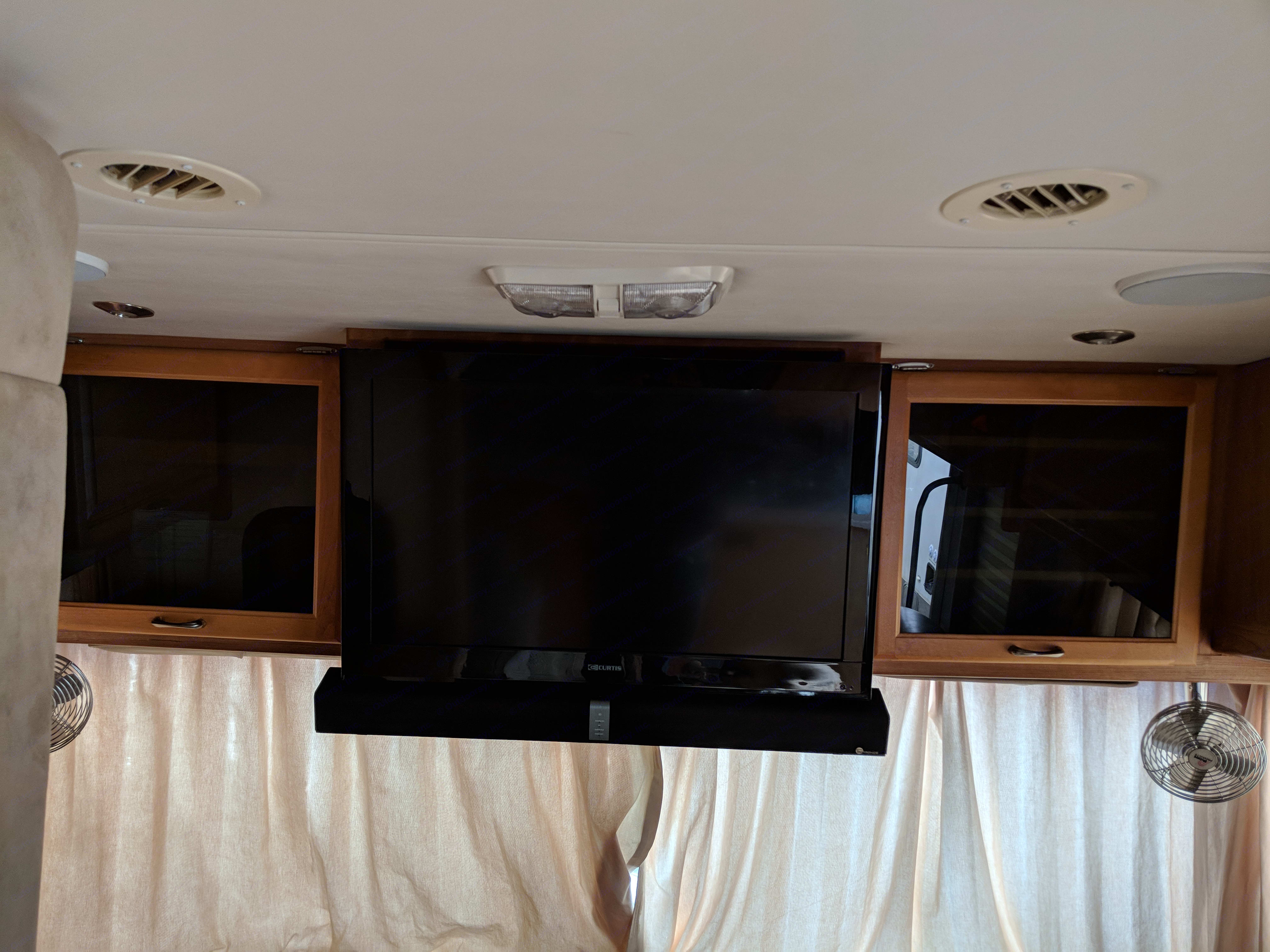 """32"""" flat screen TV with 3-4 HDMI connections. Blue tooth music bar that is attached to the TV. Can pair and play music from phone.. National Sea Breeze 2007"""