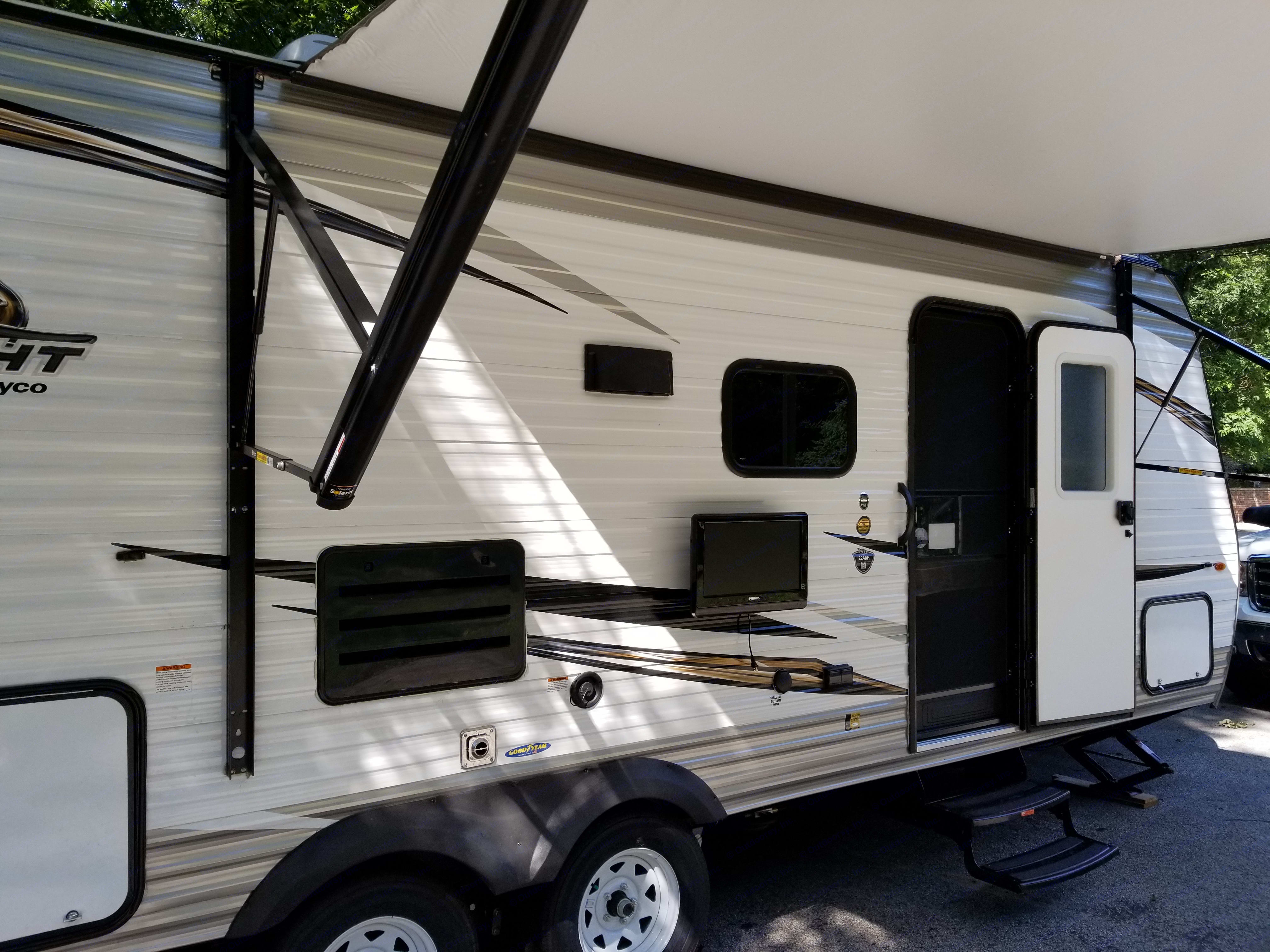 Closer view of TV mounted outside under the 13' power awning. LED strip illuminates outdoors for nighttime fun under the awning. . Jayco Jay Flight SLX 224BH 2019