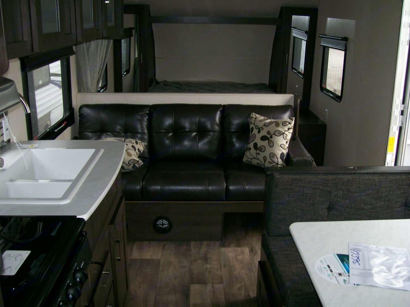 Inside pic of sofa and queen bed in the back. Forest River Cruise Lite 2018