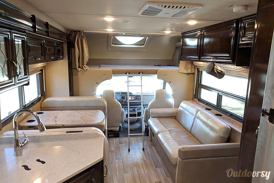 """7 seat belts for travelling and a big 40"""" TV and DVD player that swings out from the bunk for the kids to watch a movie while driving.. Thor Motor Coach Quantum LF31 2017"""
