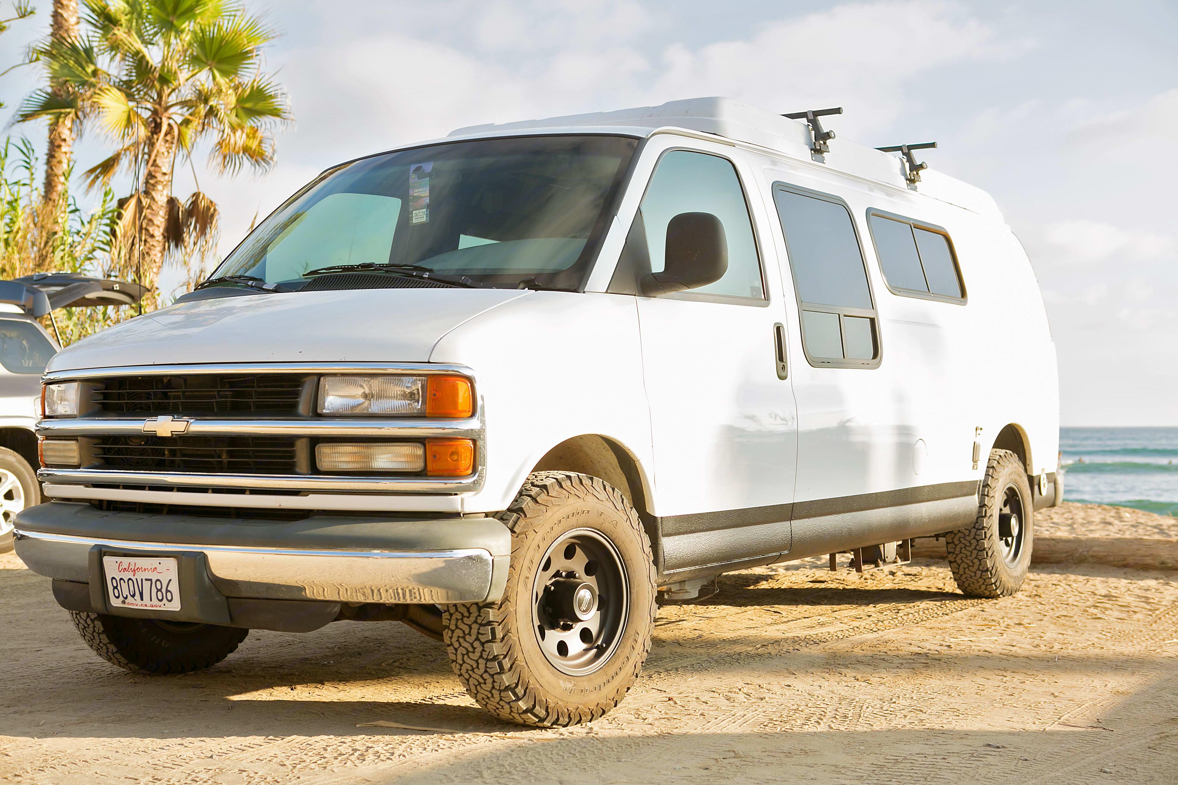 All terrain wheels, roof racks, rhino lined rocker panels and extended body ready for adventure. Sportsmobile Custom Design 1998