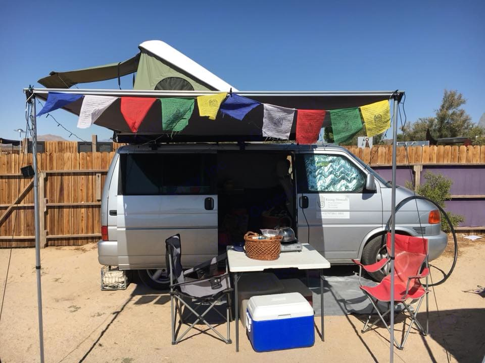 Festival ready with prayer flags up on the awning!. Volkswagen Eurovan 2003