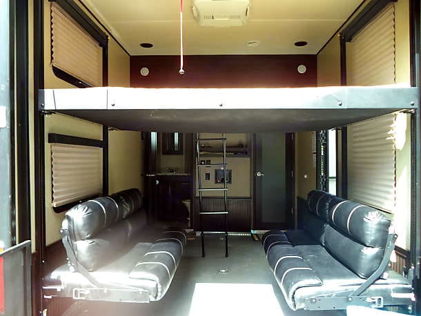 Garage area includes 1/2 bath, full size bed , seating area that folds down for more sleeping space.. Forest River Nitro XLR 2017