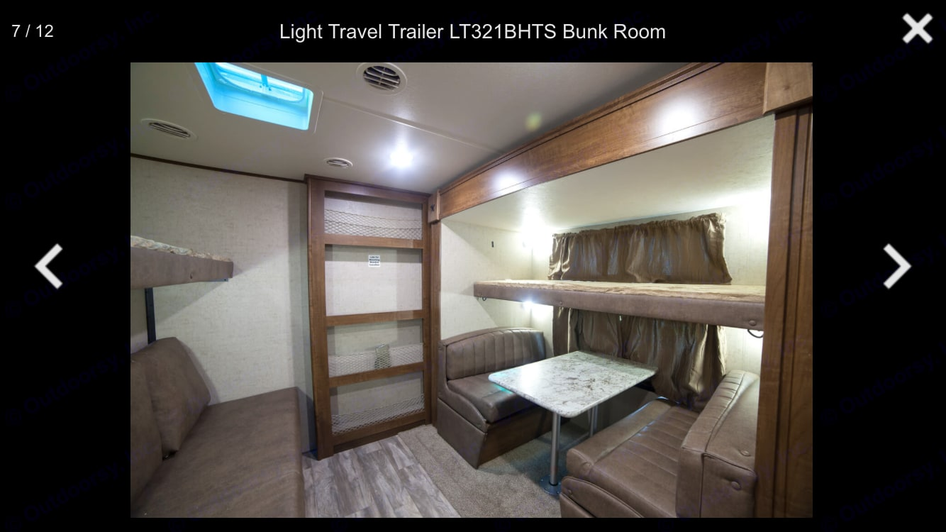 Bunk room: two bunks, one couch, and one table that converts into a bed. Space for an air mattress on the ground if needed. . Open Range Light 2018