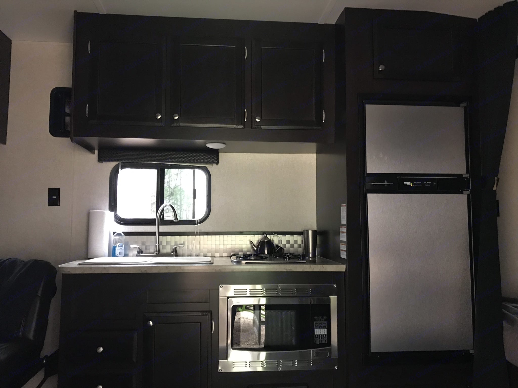 Full Kitchen with Refrigerator, Stove, Microwave/Convention Oven and Double Sink, large Pantry in Corner with plenty of storage . Jayco Octane 2017