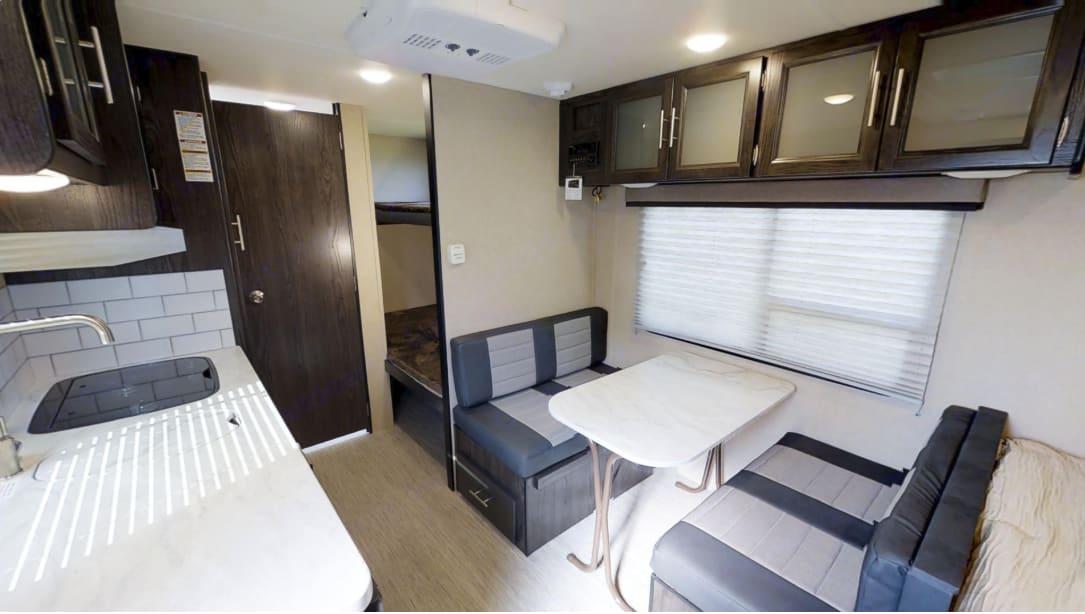 Large dinette with overhead storage. Dutchmen Kodiak 2019