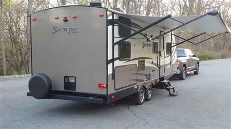 Exterior with automatic awning for shade. Forest River Surveyor 2016